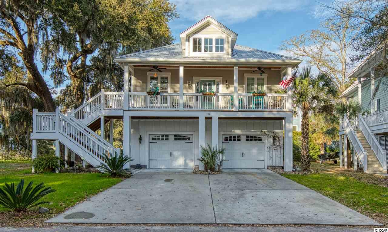 "This like new custom built home in the heart of Murrells Inlet is a must see! Located walking distance to the famous ""Murrells Inlet Marsh Walk"" with amazing restaurants, views, entertainment and a public boat launch for a day on the water! The home has two bedrooms on the first level and a large master suite on the main level off of a large open floor plan concept. Enjoy a peaceful morning and evening on your large front porch with views of beautiful protected 100 year live oak tree. Start living the good life and book your showing today!"