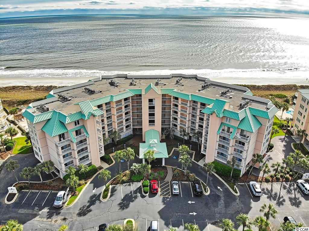 Completely renovated in 2021. Make carefree, resort-style, coastal living part of your lifestyle in this beautiful, top of the line oceanfront condo. Warwick 101 boasts single-level living with access to elevator service as well as a first floor end position with the unique advantage of having two balconies and a private staircase providing easy access to the beach and pool. Open concept common areas offer northeasterly ocean views that also overlook the pool. Split bedroom floor plan provides three en suite bedrooms, each with balcony access. All furnishings are brand new as are the luxury vinyl plank flooring, white shaker-style cabinetry and white granite counters. New stainless steel appliances include an ice maker/beverage fridge in the bar. Renovated master suite boasts a luxury stand-alone soaking tub with marble tile surround as well as a tile and glass enclosed shower. Warwick offers a private outdoor pool, hot tub and ramped boardwalk over low dunes to the beach. Litchfield by the Sea resort has 24-hour guarded security. Amenities include lighted outdoor tennis courts, fresh water fishing lake, walking/biking paths, salt marsh creek vistas and oceanfront owner clubhouse. Considered one of the finest beaches along the east coast, Litchfield Beach boasts 7 miles of soft sand. Enjoy close proximity to nationally recognized golf courses, fitness center, Starbucks, grocery stores, fine local restaurants and the renowned Brookgreen Gardens.
