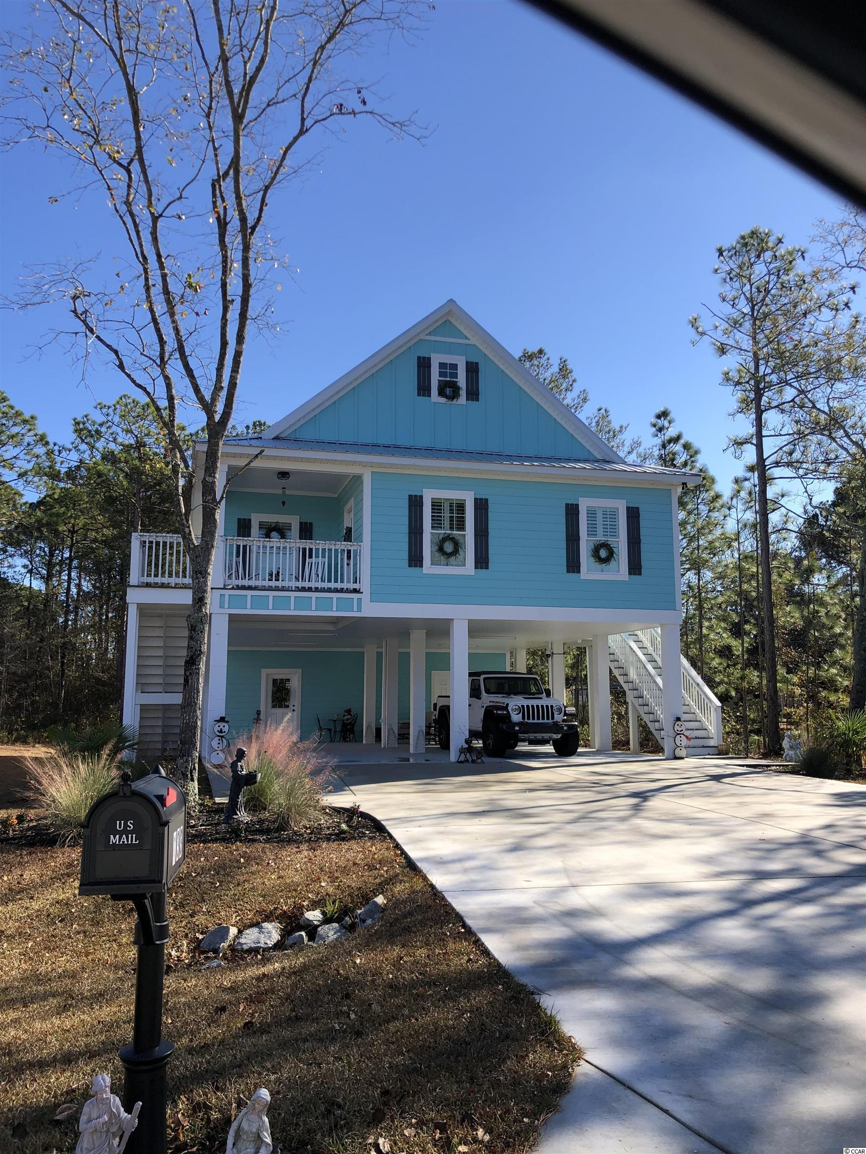 Under construction!! A beautiful 4 bedroom 3 bath raised beach home located right off of the Garden City Connector. Don't pay expensive HOA fees. This home has no HOA!! Take a short golf cart ride to the popular beaches, shopping, and dining. This home will feature a covered  porch, 9' foot ceilings, hardie plank siding, a metal roof, and a tankless water heater. The kitchen will have custom built cabinetry, stainless steel appliances, and granite countertops. Downstairs you will find a storage room and a 4th bedroom you could convert into a mancave, flex room, or an in law suite with its own full bathroom and closet. Don't miss out and come take a look today!!