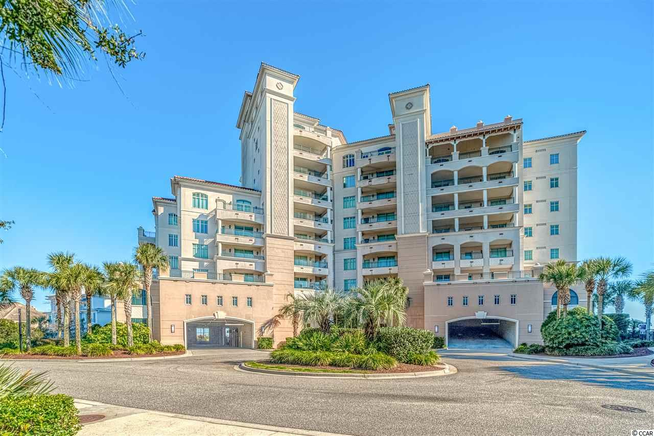 """Welcome to 1-402 in the Portofino tower on the 6th Floor of the prestigious residents only private gated community of Vista Del Mar at Grande Dunes. This luxurious 3 Bed 3.5 Bath condo has 2 ocean front balconies and one rear balcony. The condo features private elevators that take you directly to your own unit with wood and tile floors throughout the common areas and baths with carpeting in the bedrooms. Wake up to panoramic views of the sun rising over the Atlantic Ocean. The kitchen features a breakfast bar, custom cabinets, granite counters appointed with high-end appliances. The master suite features gorgeous ocean views, a large walk in closet, en-suite master bath with dual granite vanities, with shower/tub. One of the guest bedrooms has direct access to a large private balcony that has great sunset view. All bedrooms have their own private bath. This unit comes with two assigned parking spots and extra storage room. Grande Dunes stretches from the Ocean to the Carolina Bays Preserve, this 2200 acre development is amenity rich and filled with lifestyle opportunities unrivaled in the market. Vista Del Mar also includes a large oceanfront pool and Jacuzzi with private beach access, fitness room and built in grills located by the pool. Owners also enjoy the exquisite Private Ocean Club that has fine dining, oceanfront pools, meeting rooms and is truly a remarkable place for events. Amenities including two prestigious 18 hole golf courses. The Resort course is open to the public and the Nick Price designed """"Members Club"""" is open to members. Other features are a 126 wet slip deep water marina able to accommodate vessels up to 120 feet or more, and state of the art Har-Tru tennis facility. Grande Dunes is a wonderful and private community that sits conveniently in Myrtle Beach, close to shopping, dining and roughly a mile from Grand Strand Medical center. Come Live the Grande Dunes Lifestyle! Contact the listing agent for more information and to schedule a viewing. """