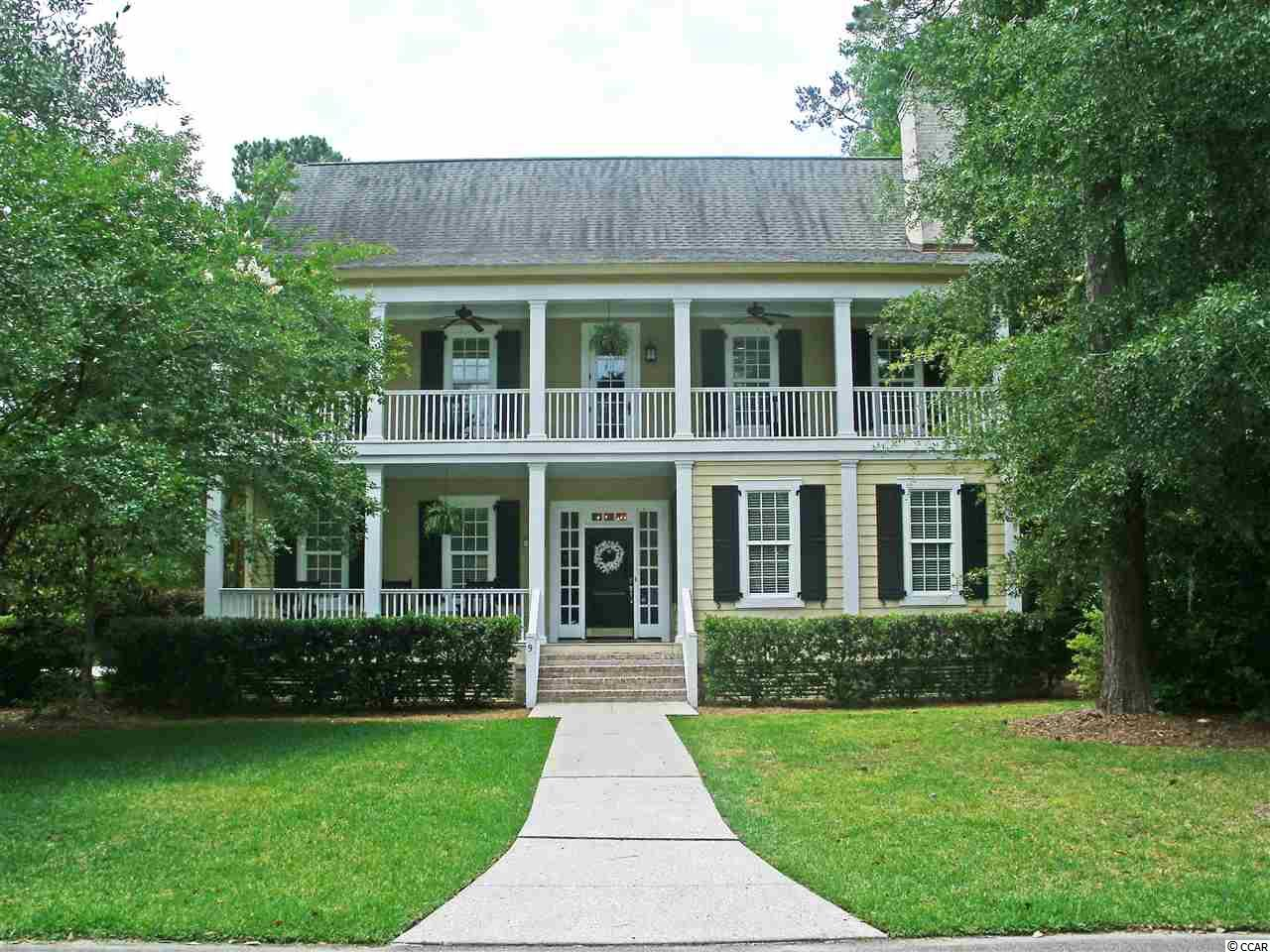 Gracious Lowcountry home offers private, sophisticated living in historic Litchfield Plantation. Classically colonnaded two-story home with double front porches features powder room, high ceilings, beautiful wood floors, gas fireplace, crown molding, custom built-ins and additional screened-in porch. Gourmet kitchen boasts stainless steel appliances, granite counters, walk-in pantry and abundant light. Master suite is on the main floor. Top floor has three bedrooms, one with an adjoining den, and three full baths. Attached two-car garage. The historic rice fields and magnificent ancient live oak forest preserved within Litchfield Plantation endow this gated community with enchantment and beauty. Homeowners also enjoy convenient access to the plantation marina, a pool with pool house overlooking the expansive rice fields as well as oceanfront beach house privileges with parking and bathroom facilities.