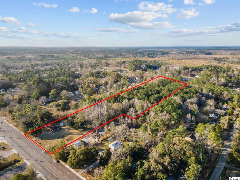 9.37 acres of land with 4 br & 2 ba brick home. Wonderful potential for this property, currently zoned as residential but can be changed toCOMMERCIAL!!!!. OWNER WILL ASSIST IF BUYER WANTS TO PURSUE COMMERCIAL REZONING. JUST ACROSS FROMNASHMINI-STORAGE. Located minutes from the heart of Georgetown. The home will make the perfect handyman's special forsomeone looking to make a home their own. Don't miss out on this great opportunity! 4 bedrooms 2 bath home needs some tlc. 9 acresof mature trees with the proper zoning, could have many uses. The property backs out to another road so it can have access from 2roads.