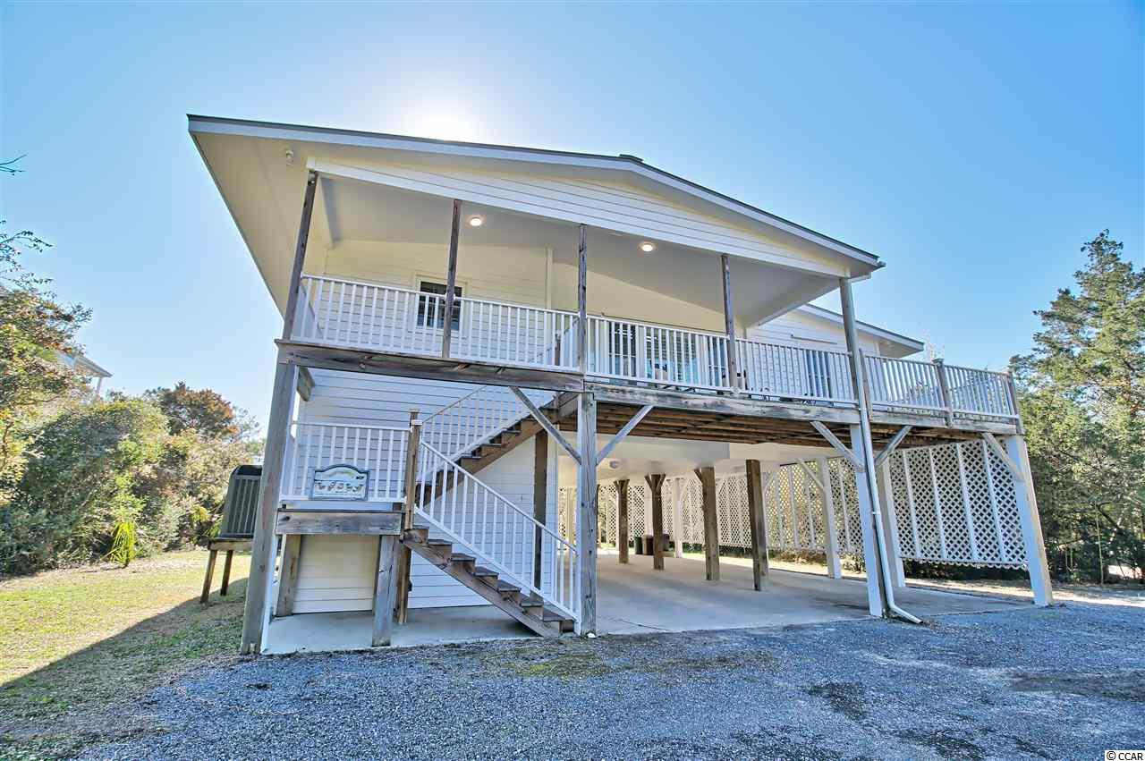 Almost oceanfront on a large lot! This classic North Litchfield Beach house is located just a very short walk to the pristine sandy beaches of Litchfield in Pawleys Island.  This home comes partially furnished and and has been almost completely renovated including recent HVAC system, new metal roof with sky lights, new composite decking, LED lights, plantation shutters, and much more.  Home features four bedrooms, three baths, and large greatroom with vaulted ceiling.  Spacious kitchen includes quartz counter tops, farm sink, and breakfast bar with plenty of room for seating.  Large enclosed back deck is a perfect space to relax and enjoy during all seasons.  Open sun deck with stairs leads to a large back yard and pathway to beach.  Enjoy picturesque views of the ocean from the widow's walk on top deck; great place to enjoy morning coffee or cocktails during sunset.  Ground level includes a workroom, two enclosed showers, outdoor shower, spacious laundry room, half bath, as well as plenty of storage for beach chairs and toys.  Fantastic family beach house that has great rental income potential for buyers looking to rent.  In addition to being located in desirable North Litchfield Beach, it is just a short drive to local attractions such as Huntington Beach State Park, Brookgreen Gardens, Hobcaw Barony, and numerous top rated public golf courses such as Caledonia and True Blue.  Visit the historic homes and Harborwalk in close by Georgetown or make day trip to Charleston, only 75 miles away.  Close to home enjoy plenty of shopping, dining, and entertainment options in Murrells Inlet and Mrytle Beach.
