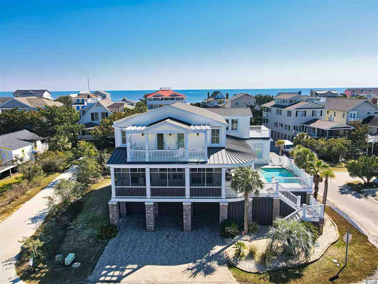 Welcome to 226 Myrtle Avenue in historic Pawleys Island, South Carolina. A 6 bed / 6.5 bath home with beautiful sunset views overlooking Pawleys creek. With the beach only steps away and a boat-ramp down the street, owners and guests will enjoy some of the best access to water and recreation that the island has to offer. Before entering the main level of the home, you will notice a raised, outdoor pool with creek views that is perfect for cooling off after a day on the beach. Upon entry, visitors will be greeted with charming heart-pine floors and beams, high ceilings, and a dual-sided brick fireplace with gas logs. With a gas cooktop by Wolfe, a Sub-Zero refrigerator and a large center island, the kitchen is fully-equipped for large gatherings and entertaining. The kitchen also features custom cabinetry and a double farmhouse sink. The owners-suite is located on the first floor and has a beautiful bath with dual sinks and a spacious walk-in shower with double heads. The first floor also has a guest suite with a private bath and a tub/shower. Moving upstairs, guests will appreciate the heart-pine flooring throughout and wainscoting down the hallways. The second floor has a total of four bedrooms, including a second master suite with a garden tub, a walk-in shower and a porch with views of the salt marsh. And if you're touring the home, don't miss the upstairs guest bedroom that leads to a sundeck with an outstanding marsh view and a peek of the ocean. Other amenities include two laundry rooms, wet bar, an upgraded three-stop elevator, Ipe exterior hardwood decking, generous parking/storage below and an outdoor shower. The home is in excellent condition and is being sold fully furnished. Don't miss this opportunity to own a luxury home on one of South Carolina's most cherished beaches.