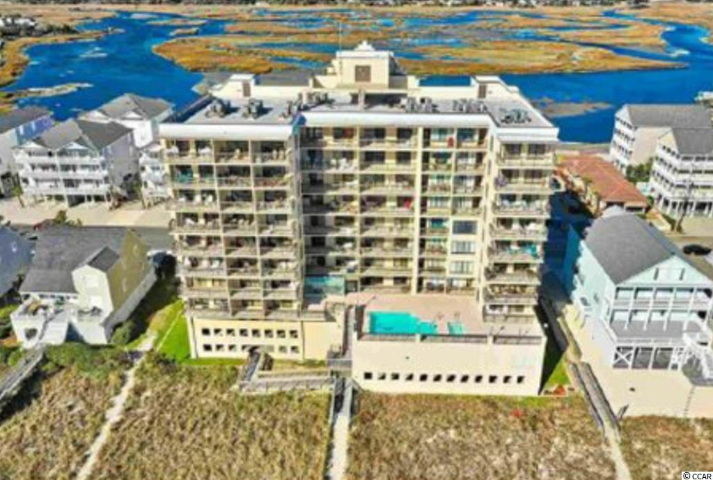 What more could you ask for than a gorgeous newly remodeled oceanfront penthouse condo with marsh views in Cherry Grove with an oceanfront pool, low HOA fees, two elevators, underground parking AND owners are allowed dogs (upon approval)!! It is extremely rare for a one bedroom penthouse to open up in this building. This unit has been completely remodeled with a modern clean beach vibe! The remodel includes a new kitchen with modern slab custom cabinets, solid surface countertop and high end appliances with beautiful new light gray tile flooring and baseboards throughout. Bathroom has new cabinets and fixtures. Popcorn ceilings have been removed and everything is freshly painted. Space saving large LG combo washer dryer allows for additional storage. Trane HVAC unit is approximately 2 years old. Keyless entry to both unit and storage closet so you will never loose your keys on the beach! Unit is being sold mostly furnished…not all items convey. No rental desk helps with loan qualifications. Buyer to verify all information. The beautiful sunrises, sunsets and moonlit nights will take your breath away. Come see today!