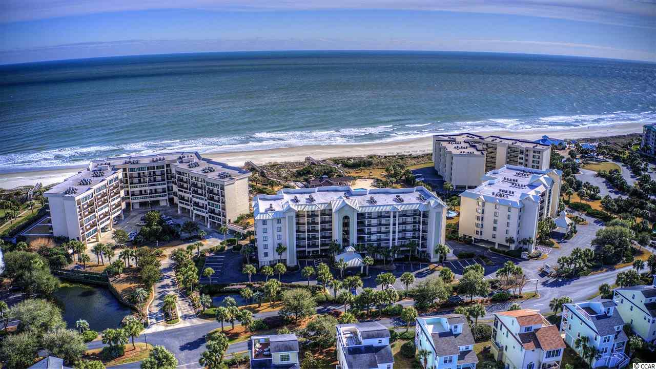 Located in the gated community of Litchfield by the Sea, this oceanfront condo offers 3 bedrooms and 3 full baths.  Located on the first floor, this unit features your very own private stairway that provides quick access to the pool, common areas, beach and the assigned parking spot.  The fully furnished interior is highlighted by the open floor plan.  All bedrooms has access to its own private bathroom. All flooring throughout the unit has recently been replaced with the widely popular LTV  flooring product.   Enjoy all the amenities of Litchfield by the Sea including tennis, fishing, walking and bike paths, marsh and creek access, & the one of the best beaches in South Carolina! You will love this low maintenance & carefree lifestyle.