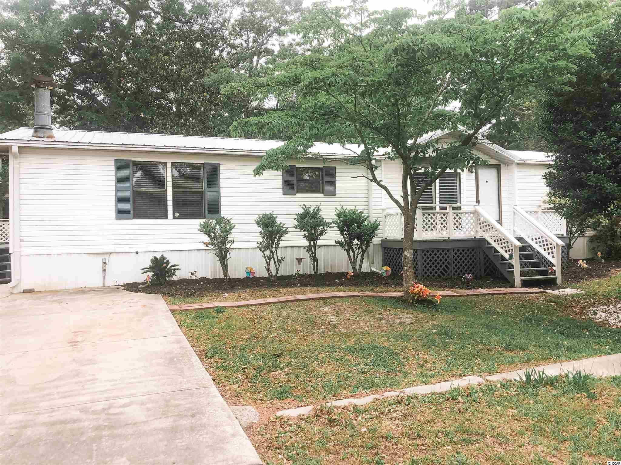 3 bedroom/2 bath - Living room, dining room, family room with fireplace, Kitchen offers a center island, breakfast bar, desk and a large laundry area.  spacious home with a one car carport and a nice storage shed, Two decks. Perfect location less than 5 minute to the beach. New AC installed 5/10/21.