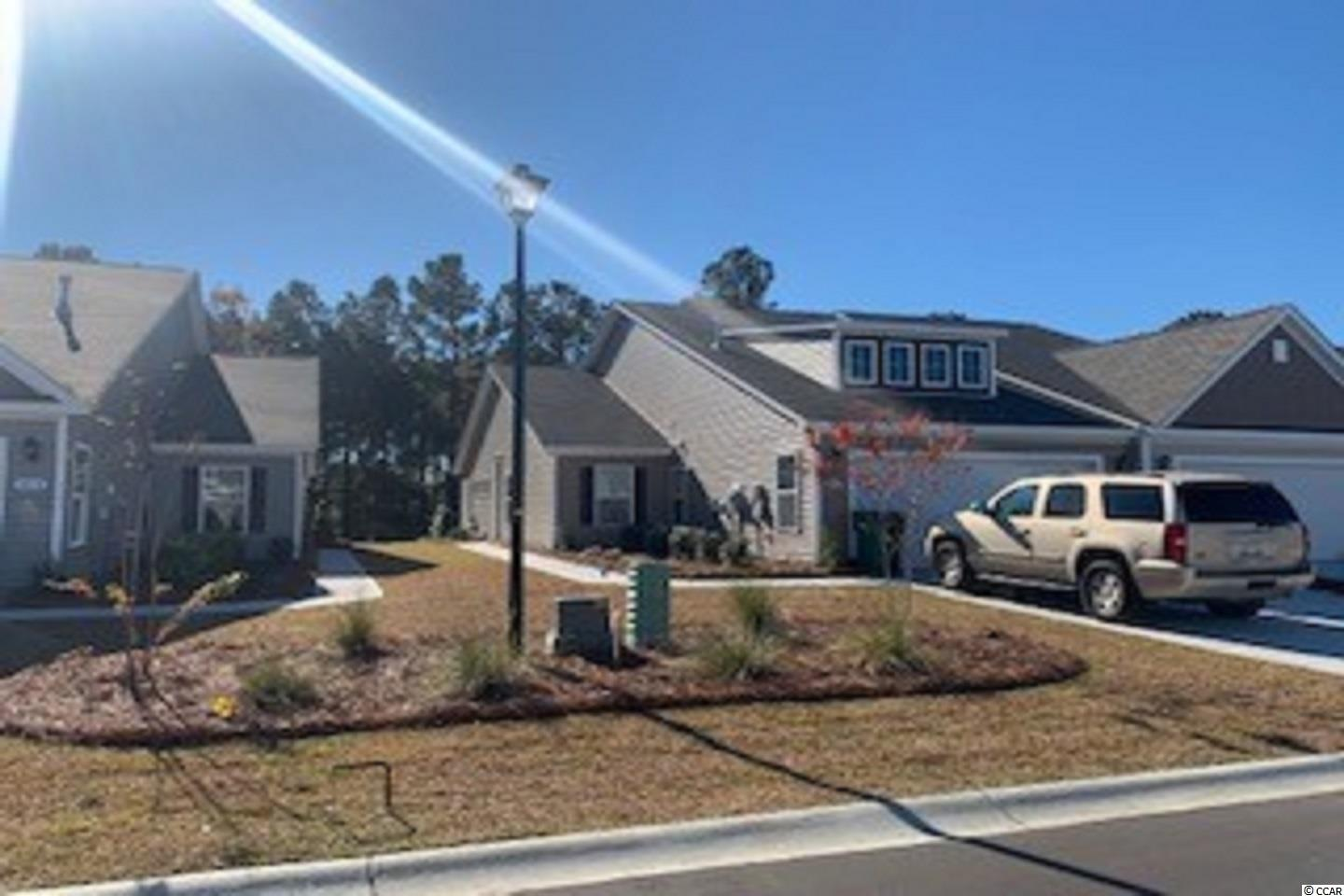 """A rare opportunity of a duplex being offered in Carolina Forest that also features an attached two-car garage! Enjoy the laid back coastal lifestyle where all of your exterior maintenance is taken care of. Upon entry you are greeted with a very open layout and high vaulted ceilings. The split bedroom floor plan offers privacy when you have guests visiting you at the beach, along with functionality. This home will also have a spacious rear covered porch that is great for morning coffee! Granite countertops, tankless water heater, 36"""" painted cabinetry, and stainless Whirlpool appliances with a gas range all included. This is America's Smart Home! Ask an agent today about our industry leading smart home package that is standard in every home.  *Photos are of a similar Tuscan home. (Home and community information, including pricing, included features, terms, availability and amenities, are subject to change prior to sale at any time without notice or obligation.  Square footages are approximate.  Pictures, photographs, colors, features, and sizes are for illustration purposes only and will vary from the homes as built.  Equal housing opportunity builder.)"""