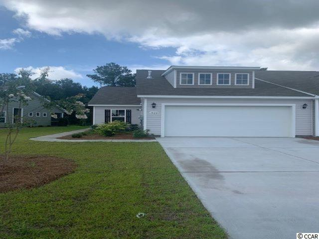 A rare opportunity of a duplex being offered in Carolina Forest that also features an attached two-car garage! Enjoy the laid back coastal lifestyle where all of your exterior maintenance is taken care of. Upon entry you are greeted with a very open layout and high vaulted ceilings. The split bedroom floor plan offers privacy when you have guests visiting you at the beach, along with functionality. This home will also have a spacious rear covered porch that is great for morning coffee! Granite countertops, tankless water heater, modern gray painted cabinetry, and stainless Whirlpool appliances with a gas range all included. This is America's Smart Home! Ask an agent today about our industry leading smart home package that is standard in every home.   *Photos are of a similar Tuscan home. (Home and community information, including pricing, included features, terms, availability and amenities, are subject to change prior to sale at any time without notice or obligation.  Square footages are approximate.  Pictures, photographs, colors, features, and sizes are for illustration purposes only and will vary from the homes as built.  Equal housing opportunity builder.)