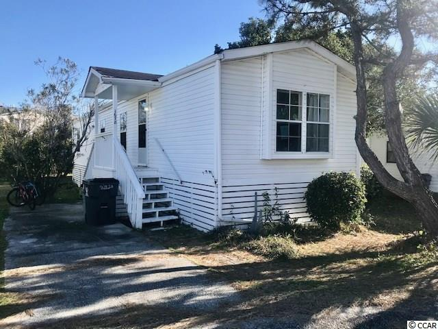 Some  TLC  will take this home a long ways. Home has a nice height off ground, plenty of space to make any type of repairs underneath this home. Deck overlooking nice backyard with palm tree.  Come make you dreams come true.