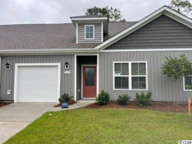 Brand new community within walking distance to the Murrells Inlet Marsh Walk! Low maintenance living at its best with these single level townhomes. Our Bentley floorplan is masterfully designed with an open concept kitchen, living, and dining area that is perfect for guests visiting you at the beach! Features include white painted cabinetry, granite counters in the kitchen, stainless Whirlpool appliances, and laminate wood flooring that flows throughout the main living areas. This home also boasts a versatile flex space with French doors that would make a great formal dining room or home office. The primary bedroom suite is tucked away at the back of the home with a walk-in closet along with a private bathroom with dual vanity and large shower. Enjoy the beautiful coastal weather on the rear covered porch with pond views! One-car garage with garage door opener plus a spacious storage closet off the rear porch. It gets better- this is America's Smart Home! Ask an agent today about our industry leading smart home technology package that is included in each of our homes.  *Photos are of a similar Bentley home. This home is under construction. (Home and community information, including pricing, included features, terms, availability and amenities, are subject to change prior to sale at any time without notice or obligation. Square footages are approximate. Pictures, photographs, colors, features, and sizes are for illustration purposes only and will vary from the homes as built. Equal housing opportunity builder.)