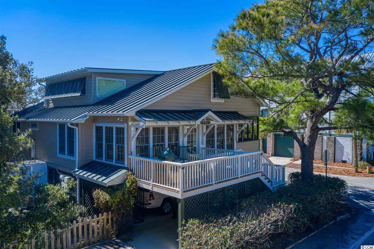 A true Pawleys Cottage with best location off ocean. North end of pawleys on corner   of Third street and Myrtle Avenue. Third street is one block long running from ocean to creek. Boat ramp at creek and walkout to beach at ocean. Perfect location.  This home has been extremely well maintained and offers a lot with shade trees and garden area not found in most beach homes Fenced property and screened underneath for great outdoor times. Interior first floor has neartpine floors and beadboard ceilings. Large central living area opens to kitchen and dining. Big pantry/laundry room has oversized washer dryers. Gas cooktop, stainless appliances. All windows with custom plantation shutters. Entrance area is a Carolina Room. Small Screened porch off dining area with views of creek. There are three bedrooms and 2 baths on main floor.  Upstairs overs two large bedrooms each with own full bath. one bedroom has extra closet or nursery area. Sitting area upstairs has storage and is great sleeping area for small children.  Outside is an oversized lot with plenty of parking and space for pets and people. Storage under house is vast and enclosed and lockable with vented walls for flood compliance. Screened area for barbequing and parties. Side of home has extra parking are for cars or boat. Boat ramp within 150 feet.  A perfect location on Pawleys for a much loved true Pawleys Style cottage.
