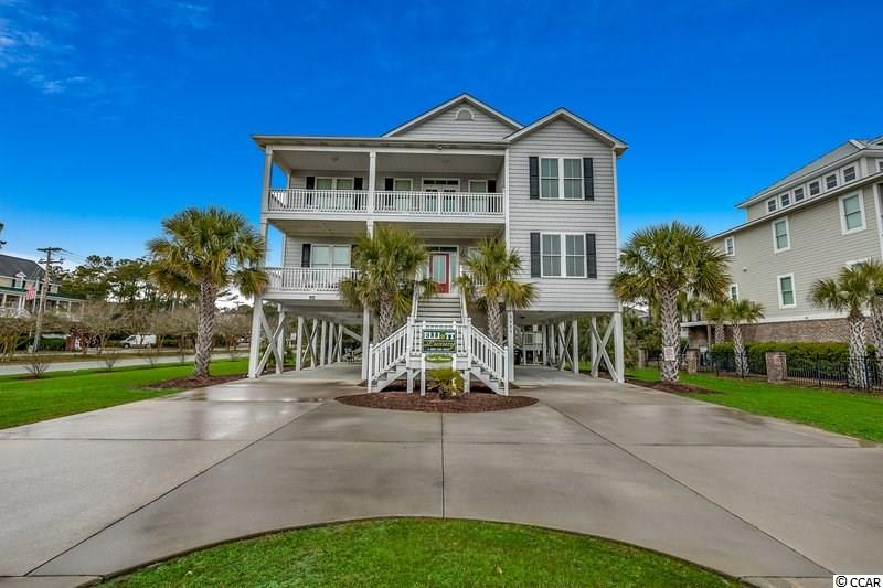 Welcome Home to Hughes Paradise located in the Prestigious Tilghman Estates. You will love the amazing ocean views from this 5 bedroom, 4.5 bath second row raised beach home.  This newly built home provides everything you need and  with over 3000 heated sq. ft.   The fully equipped, spacious  kitchen has stainless appliances, granite counter tops, breakfast bar and plenty of room for  the entire family.  Other home features include two master bedroom suites ( one on each floor), elevator, game room, outdoor pool and much more.  This home is currently used as a luxury rental with great rental income or it would make a perfect primary residence. Don't miss out on this well maintained home as it won't last long!