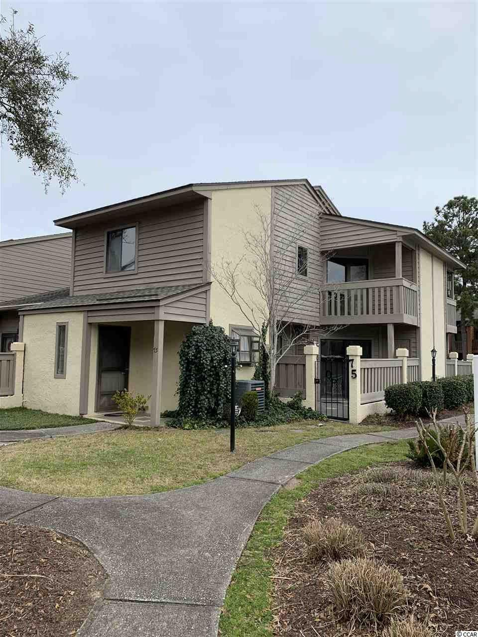 A charming 2 bedroom 1.5 bath townhouse East of Business 17 in Surfside, in the quiet community of Ocean Pines. This is a true Townhouse. No flood insurance required! Short walk or golf cart ride to the beach (approximately 4 blocks). Ocean Pines is a pet, golf cart and motorcycle friendly community showcasing private/gated swimming pool and tennis courts. HOA includes internet, cable, amenity upkeep, community landscaping, parking and trash pickup. Unit 75 is an end unit beside the pool and tennis court. It was used as a private residence by one individual and never rented. The home features a large living and dining room space that looks out onto the patio next to the swimming pool. Both bedrooms and the full bathroom are located upstairs. The master bedroom features a walk-in closet and a balcony that overlooks the pool and tennis courts. The half bath is located downstairs. All appliances remain. Hurry! It won't last long! ,