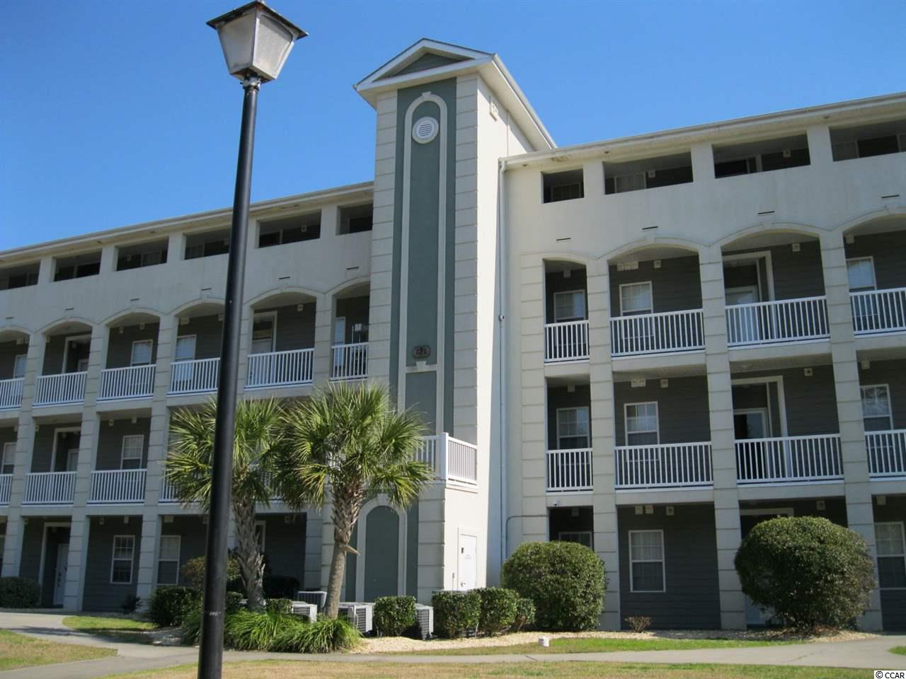 This outstanding 3BR/2BA condo is located on the First Floor in Carolina Yacht Landing, Little River, SC.  The extended bay window in the living room makes this a very spacious condo where you can enjoy the peaceful view of two fountains in the pond from your living room, master bedroom, or screened porch.  You will appreciate the privacy of the large master bedroom with his and her closets, and your guests will welcome the size and privacy of the guest bedrooms.   The condo has crown molding, and will accommodate a full size washer and dryer.   You will appreciate the security of being a gated community as well as the security patrols.   Only steps from the pool, hot tub, boat parking, with boat slips available. Just minutes from shopping, dining, golf and the beach make this a wonderful place for you to enjoy downtime, family and friends.   Don't miss out on this! Must See This Outstanding Condo! Make your appointment today.   Square footage is approximate and not guaranteed. Buyer is responsible for verification