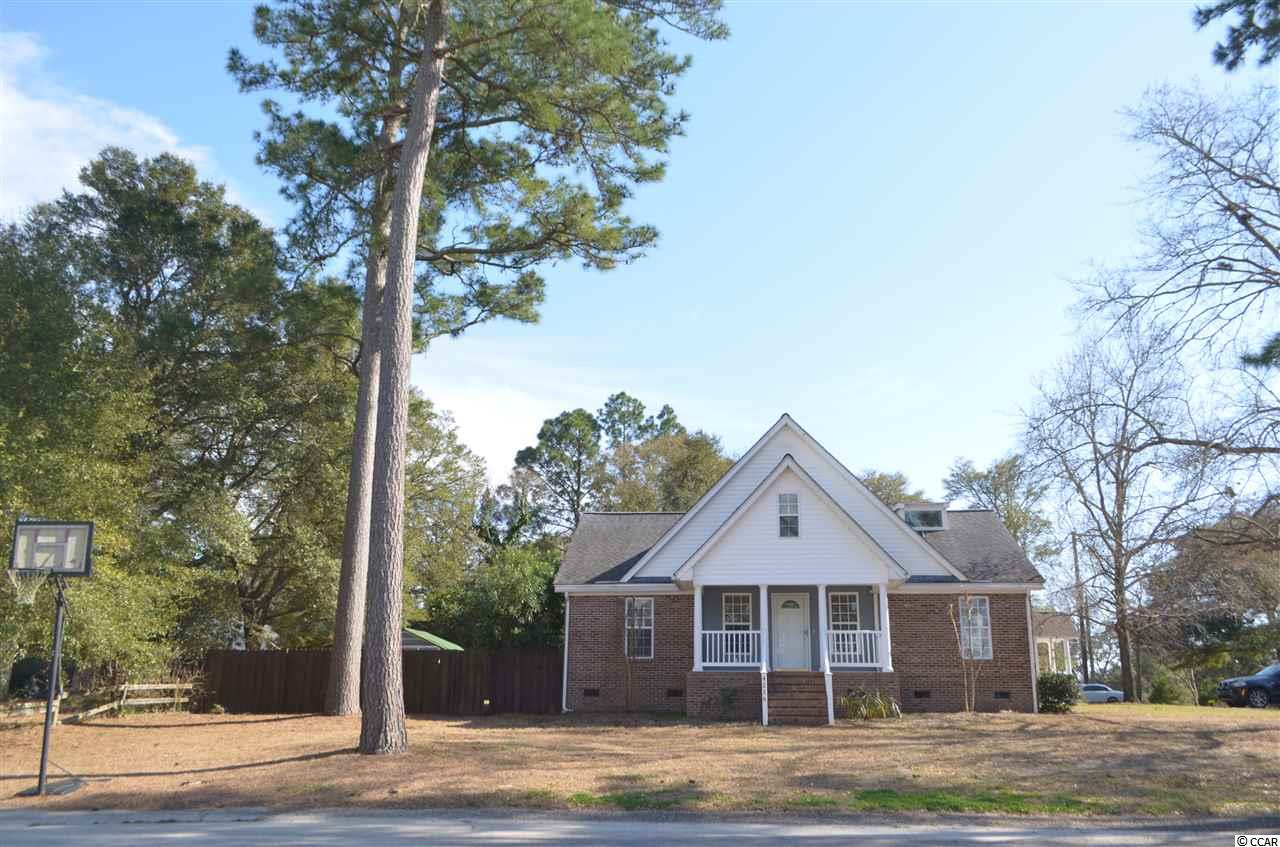 Welcome to this Beautiful 5 Bedroom, 2.5 Bath Brick Home, Corner Lot, NO HOA located in Peaceful Little River.  This was originally a 1965 beach cottage, moved to its current location in 2004 where the second floor was added and brought up to 2004 codes.  Two New HVAC Systems and Water Heater in 2019.  Kitchen and Master Bath remodeled in 2019.  New Flooring throughout in 2016.  Updated Guest and Half Bath in 2020.  The first floor has 3 Bedrooms  with two large bedrooms on the second Floor.  Walk-in Shower and 6 Foot Jetted Tub in the Master Bath.  Fenced in Yard and Screened Porch with a Pet Door perfect for your 4-Legged Friends. Enjoy morning coffee or an evening beverage as you walk to sit underneath your Pergola covered in Yellow Jasmine.  Home also features a Whole House Water Purification system.  You can walk to 2 Fine Dining Restaurants as well as my favorite Mexican Restaurant.  5 minutes to North Myrtle Beach with Shopping, Restaurants, and Entertainment and only 10 minutes to the Atlantic Ocean. Come see this Great home today.