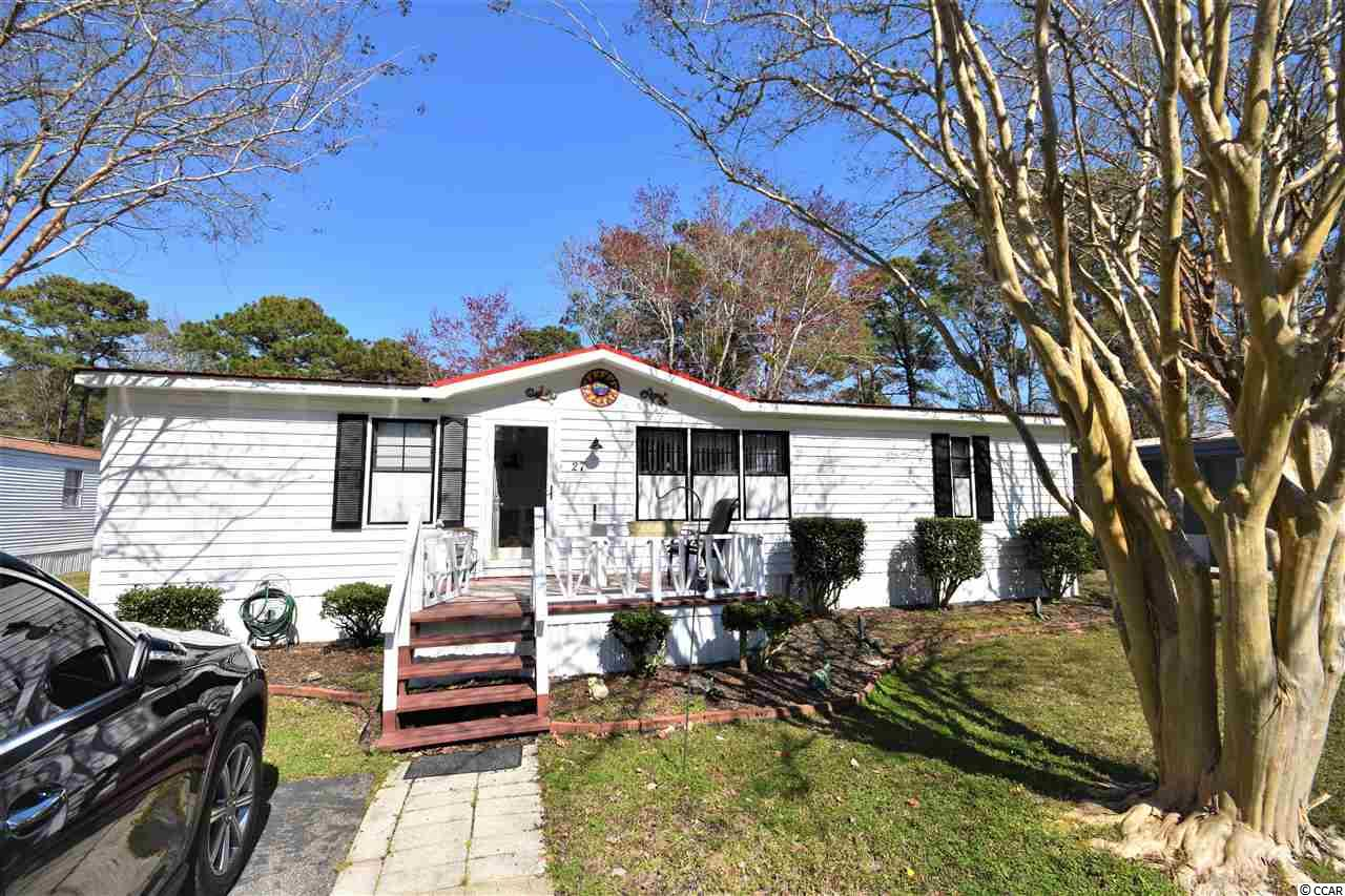 NEWLY RENOVATED!!! Check out this 2-bedroom, 2-bathroom double wide mobile home in Windjammer Village just minutes away from the beach! Newer vinyl plank flooring in the living room, tile in the bathrooms and kitchen, carpet in the bedrooms. AMAZING sunroom that can even be used as a 3rd bedroom! Roof and vinyl skirting around the outside have been newly replaced. All appliances just replaced as well! Newer outdoor shower with hot AND cold for rinsing off sand after a day at the beach and it's close to the outdoor shed where you can store your beach supplies! *** LOCATION, LOCATION, LOCATION*** This home won't be on the market long! Only a short 5-minute drive to The Pier at Garden City, Inlet Square Mall, Walmart, Kroger, and a wide variety of restaurants. Not to mention only a 7-minute drive to the famous Murrells Inlet Marsh Walk, International Club of Myrtle Beach, and Tupelo Bay Golf Center. ***BRING ALL OFFERS!!! SELLER IS EXTREMELY MOTIVATED!!!***