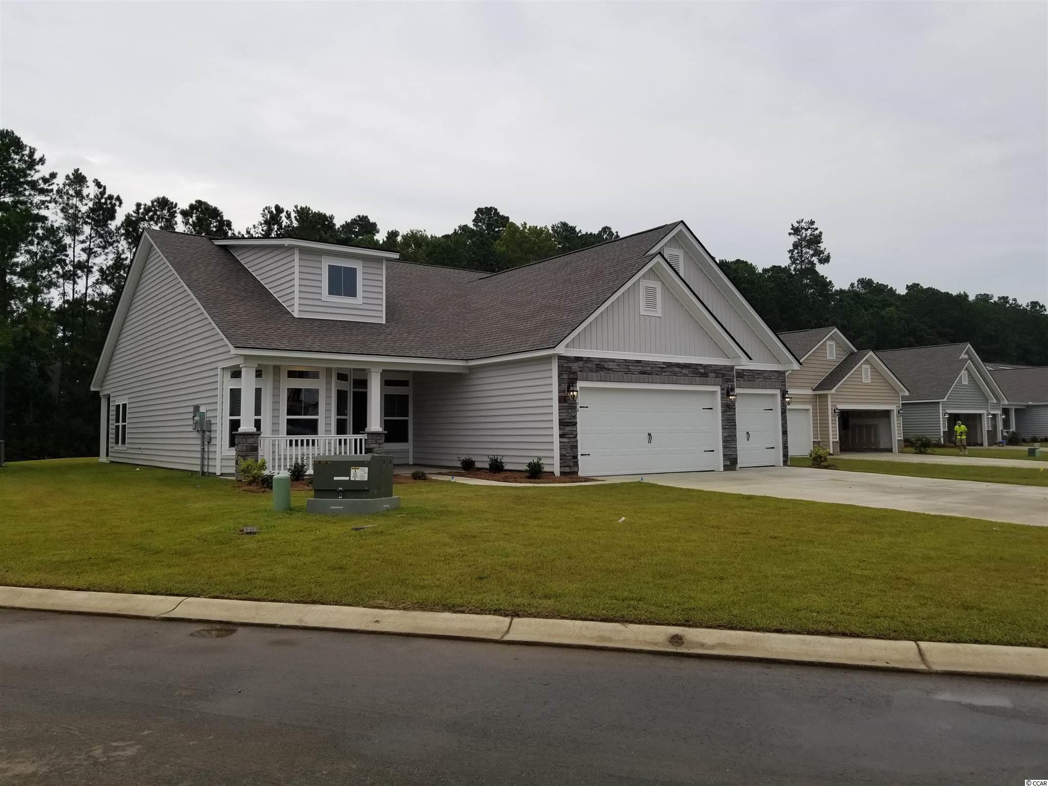 """This home will be MOVE IN READY Mid-July 2021.  This Lexington plan has 3 car garage and is located on a beautiful large pond. It features an upgraded kitchen with huge island and breakfast nook which overlooks the open great room and a separate office/flex room .  Included in this home is a Home Automation system, WIFI Certified, laminate floors, granite counters  42'""""staggered cabinets and GE stainless appliances. Forestbrook Estates is a natural gas community which will offer an amenity including pool, cabana and community garden.  Situated in the Forestbrook area of Myrtle Beach, you are literally minutes to the beaches, shopping, dining and theaters.     **Photos are of our Lexington model home and includes upgraded features."""