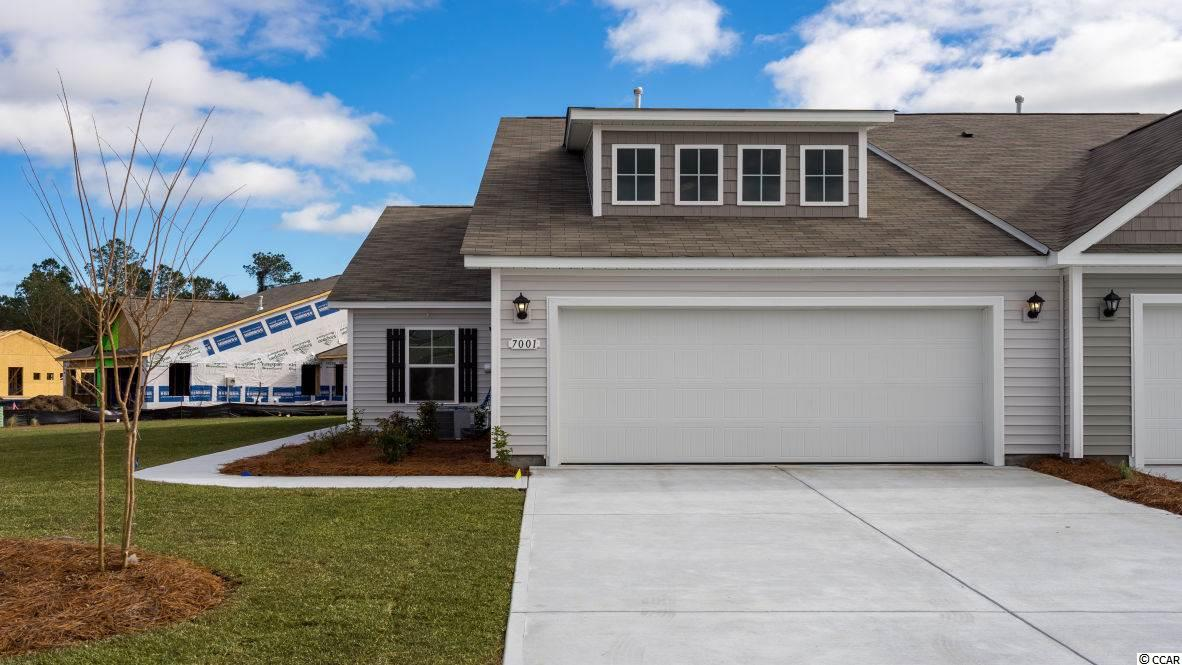 A rare opportunity of a duplex being offered in Carolina Forest that also features an attached two-car garage! Enjoy the laid back coastal lifestyle where all of your exterior maintenance is taken care of. Upon entry you are greeted with a very open layout and high vaulted ceilings. The split bedroom floor plan offers privacy when you have guests visiting you at the beach, along with functionality. This home will also have a spacious rear covered porch with pond views that is great for morning coffee! Granite countertops, tankless water heater, white painted cabinetry, and stainless Whirlpool appliances with a gas range all included. This is America's Smart Home! Ask an agent today about our industry leading smart home package that is standard in every home.  *Photos are of a similar Tuscan home. (Home and community information, including pricing, included features, terms, availability and amenities, are subject to change prior to sale at any time without notice or obligation.  Square footages are approximate.  Pictures, photographs, colors, features, and sizes are for illustration purposes only and will vary from the homes as built.  Equal housing opportunity builder.)