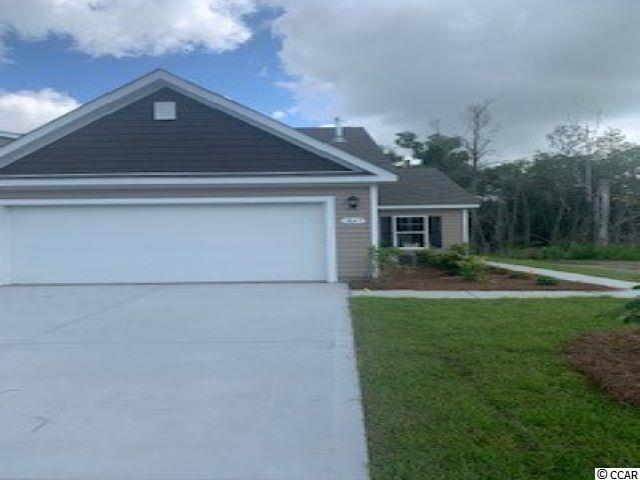 """A rare opportunity of a duplex being offered in Carolina Forest that also features an attached two-car garage! Enjoy the laid back coastal lifestyle where all of your exterior maintenance is taken care of. Upon entry you are greeted with a very open layout and high vaulted ceilings. The split bedroom floor plan offers privacy when you have guests visiting you at the beach, along with functionality. This home will also have a spacious rear covered porch with pond views that is great for morning coffee! Granite countertops, tankless water heater, 36"""" painted cabinetry, and stainless Whirlpool appliances with a gas range all included. This is America's Smart Home! Ask an agent today about our industry leading smart home package that is standard in every home.  *Photos are of a similar Tuscan home. (Home and community information, including pricing, included features, terms, availability and amenities, are subject to change prior to sale at any time without notice or obligation.  Square footages are approximate.  Pictures, photographs, colors, features, and sizes are for illustration purposes only and will vary from the homes as built.  Equal housing opportunity builder.)"""