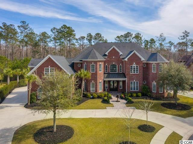 Welcome home to this stunning all brick home situated on over 2 acres with direct access to Collins Creek located in the highly desirable neighborhood of Creek Harbour.  WOW will be what you say as you enter the grand foyer.  Head into the formal living room with lots of natural light from the wall of windows.  For less formal entertaining, relax in the family room and gather around the cozy fireplace on those chilly winter evenings.  Enter the screened porch and enjoy the afternoon breeze or light a fire in the fireplace and enjoy the outdoors into the evening.  The chef of the family will love the kitchen complete with white cabinets, center island, beautiful tile backsplash, stainless steel appliances including a smart refrigerator and granite counters.  There is also a breakfast bar perfect for those quick meals or for the kids to do their homework.  Situated between the kitchen and family room is an eating area perfect for family dinners.  For more formal entertaining, there is a separate dining room featuring a triple tray ceiling and eye-catching chandelier.  Retreat to the owner's suite with a sitting area, two walk-in closets, and ensuite with dual vessel sinks, a custom 2-person soaking tub, walk-in shower, and separate water closet.  There is another bedroom on the first floor that could be used as a nursery or home office.  Upstairs are additional bedrooms all with their own bathroom, a recreational room complete with a wet bar, and a sitting area with access to the balcony overlooking the backyard.  Head outside and enjoy al fresco dining on the covered patio while the kids play in the inground pool surrounded by a paver patio.  Relax in the hot tub or around the built-in firepit.  Plenty of storage in the attached 3 car garage.  There is also a 2-car detached garage which also has a studio unit on the second floor perfect for a mother-in-law suite, an art studio, work-out room, home office, man cave or more.  Home is protected with security system and 