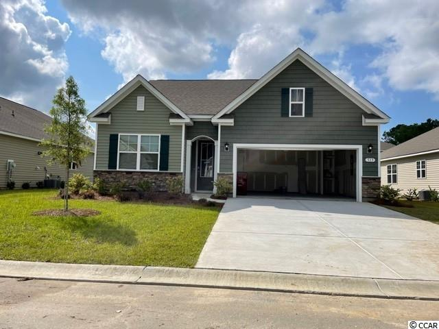 New phase now selling! Hidden Brooke is a beautiful community with an amenity that includes a pool with large deck area, clubhouse, exercise room, and fire pit overlooking the water. Minutes away from Highway 31 which provides quick and easy access to all of the Grand Strand's offerings: dining, entertainment, shopping, and golf! Tranquil setting just a short drive to the beach. This Acadia home features a beautiful exterior with an arched entryway, stone accents, and a tall entry door with glass. Open interior layout with 9 ft. ceilings and a great definition of space. The kitchen boasts a large pantry, granite countertops, modern gray painted cabinetry, and stainless Whirlpool appliances. The split bedroom design creates a private primary bedroom suite at the back of the home with en suite bath featuring a double vanity, large shower, walk-in closet, and a linen closet. Conveniences like a tankless water heater, beautiful yet durable laminate wood flooring throughout the main living areas, and our industry leading smart home technology package are also included. This home will also offer a covered rear porch which is great for morning coffee.  *Photos are of a similar Acadia home.  (Home and community information, including pricing, included features, terms, availability and amenities, are subject to change prior to sale at any time without notice or obligation. Square footages are approximate. Pictures, photographs, colors, features, and sizes are for illustration purposes only and will vary from the homes as built. Equal housing opportunity builder.)