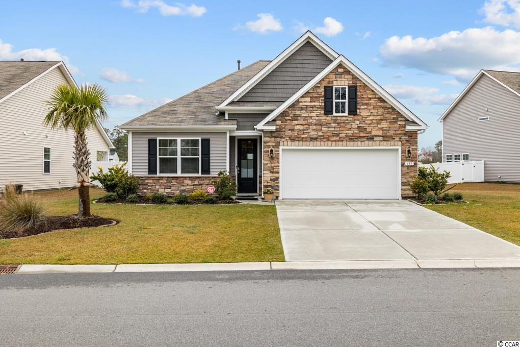 Welcome home to this beautiful 1 story ranch in the heart of Surfside Beach! Take your golf cart on a short ride to the beach, restaurants, entertainment, and all that Surfside Beach offers. This home is in The Retreat at Ocean Commons and has a great large lot location on a lake! It was originally built by D.R Horton and is the Clairborne Floor Plan with brick elevation.. This floor plan is ALL ONE LEVEL and is 4 bedrooms and 2 full baths. It features an open floorplan with upgraded tile floors in the living areas and the kitchen. There is white cabinets, upgraded granite countertops, a breakfast bar, dining nook, and a gas range. Outside, enjoy a 12x12 screened in rear porch, several palm trees in the back yard, and a nice view of the lake. There is a separate laundry room with a washer and dryer and 2 car garage. The Retreat at Ocean Commons is centrally located and is a short golf cart or bike ride to the beach, and a short drive to the entertainment of Myrtle Beach, Market Common, and Murrells Inlet. Enjoy the the shopping, dining and golf that this area offers. Schedule your showing today!