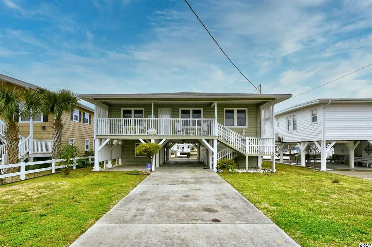 Welcome home to your beautiful new 3 bedroom, 2 bathroom raised beach house! Located in the family friendly area of Cherry Grove, you have everything you need here and more. With this raised beach home, you will have plenty of parking available. This is the perfect spot for all of your entertainment needs, especially when there is boat ramp just once street over. This beach house has a couple of decks, so head out back to see that amazing view that your new home has to offer. Step right onto the detached deck over top of the water, and don't forget that fishing rod, or you can head upstairs to the spacious attached deck to get an ever better overall view. You even have an outdoor shower area for your convenience, as well as more outdoor storage. You will find that this well-kept home has gorgeous wood flooring all throughout. Located in the area of Cherry Grove in North Myrtle Beach, you are down the street from the Atlantic Ocean! You will also be just 10 minutes from a couple of your favorite places, including;  Publix's, Hobby Lobby, HomeGoods, CVS, Food Lion, plenty of restaurants, and note that this area will meet all of your entertainment needs. This house will be great for your new home, second home, investment, rental property or half and half. Schedule your appointment today!