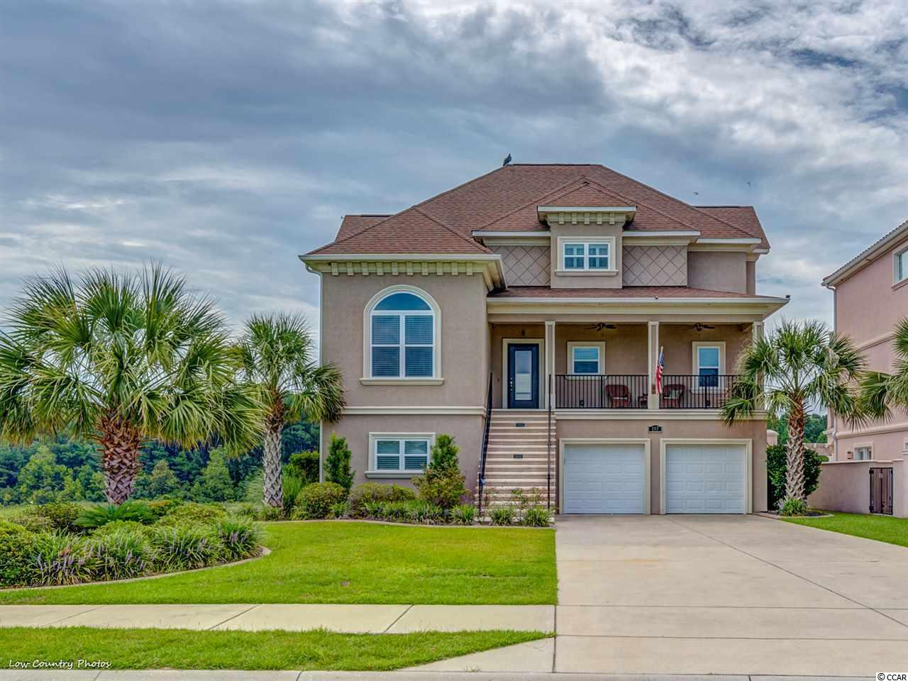"""Intracoastal Living at its finest. This mint condition home is located at The Bluffs on the Waterway in Myrtle Beach, SC. 197 Avenue of the Palms offers you the lifestyle you deserve. Boasting over 3700 heated square feet and almost 6000 square feet under roof, this is """"the one"""" for you. The residence's central living area has impressive sightlines that provide ample natural light but afford endless vistas of the waterway and passing watercraft. A spacious kitchen with plentiful cabinet space flanked by a large breakfast nook and sitting area has an equally impressive view. Rounding out the central living area is a guest bedroom and a flex room that could be an office, game room, or a formal dining room. You have an oversized master retreat with a sitting area and access to a private balcony on the top level. The en-suite bath and walk-in closet were well thought out and designed for maximum functionality. Additionally, there is a guest bedroom on the opposite side of the home on this level, affording the owner and guests their evening privacy. The home's lower level has the fourth bedroom, currently used as an office, and a downstairs living area that could have multiple different uses. The massive 1000 square foot 2-car garage has more than enough room for cars, golf carts, toys, and storage. With covered decks, patios, and balconies, this Intracoastal Waterway home has outside living areas that will provide countless hours of relaxation. The Bluffs on the Waterway is an established gated community on the west side of the ICW. Offering two clubhouses, pools, a play area, dry dock storage, and a private boat launch, this community has everything to make your dream a reality. The Bluffs is only a short four and a half-mile drive to the vast, friendly sandy white beaches that have made Myrtle Beach world-famous. Shopping, Restaurants, Award Winning Schools, World-Class Golf, Vegas-like Entertainment, and many other features that will complement your new lifestyle are"""