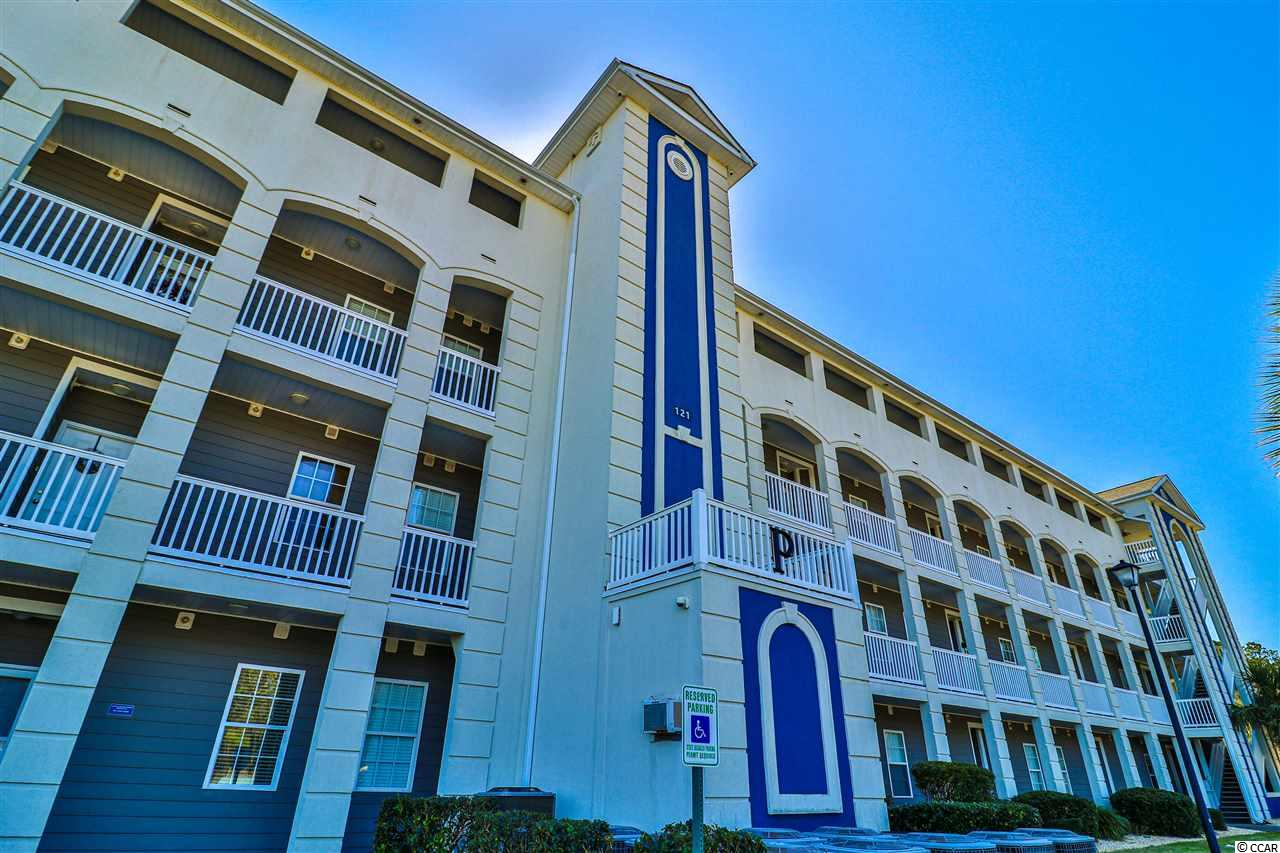 Fabulous first floor, 3 bedrooms, 2 bath condo in the gated Intercostal Waterway community of Carolina Yacht Landing! The open floor plan features architectural design, crown molding, a combo living room/dining room, and a breakfast bar. The open kitchen has lots of cabinets, a pantry, some stainless steel appliances, ample counter space, and modern lighting. Looking out you will enjoy the peaceful view of the lake and fountain. Carolina Yacht Landing is a gated community with two outdoor pools, a hot tub, a fitness center, clubhouse, boat slips, and boat storage available. There are two ramps for boat drops and fifty-three community slips that will hold up to a 26-foot boat. You are just minutes from the best beaches, shopping, dining, entertainment, and fishing. This is the perfect spot for a primary home, vacation home, or investment property. Move-in ready!