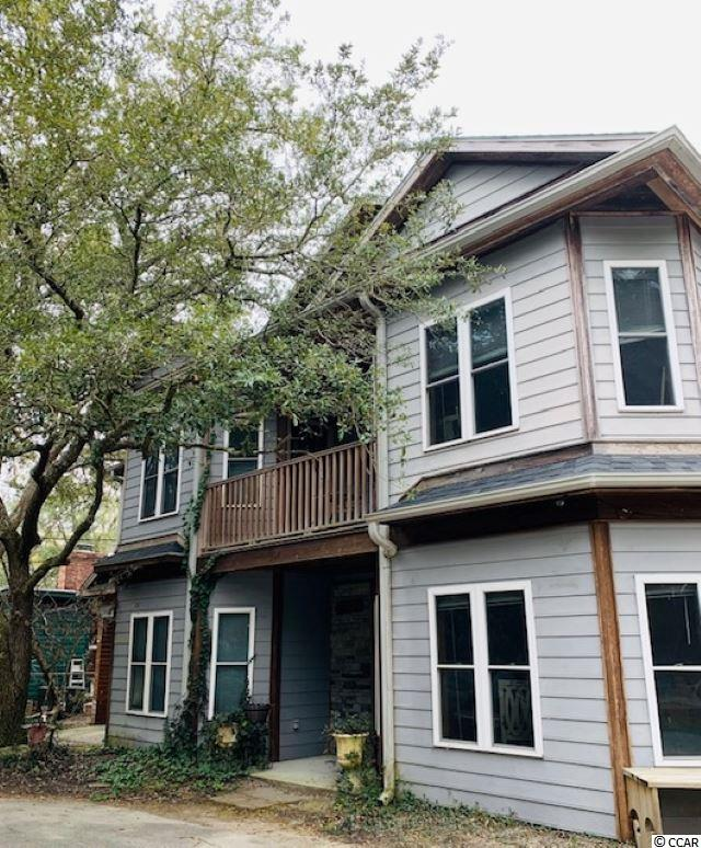 """This is a unique opportunity to live in beautiful Pawleys Island and have a six figure income generated from this property. Reside in one property and rent the other 7- with room to grow. Possible Venue location.  Proven income and many upgrades.  Property is being """"Sold As/Where Is"""". Serious inquiries only."""