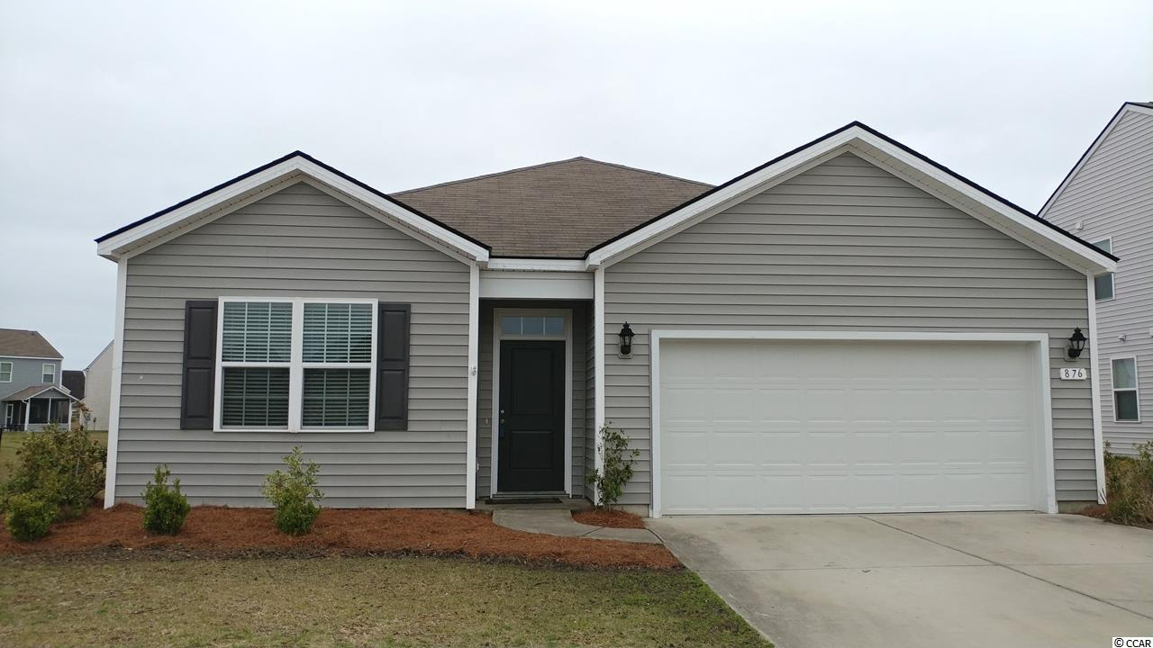 This is the very popular Cali model built by D.R. Horton with 4 bedrooms and 2 full baths all on one level ranch style home. It offers 9' ceiling upgrade and extension of the dining/living area to provide more heated sqft when owners purchased it from the builder in 2015. Total of 1861 heated plus attached 2 car garage. The house offers an open and airy layout which is perfect for daily life and entertainment. As you walk into the house, first and second bedroom with a full bath in between and 2 coat closets are on the left, laundry and 3rd bedroom to the right of the hall way which leads to the open kitchen, living/dining area. Kitchen comes with granite countertop, plenty of 36' staggered cabinets with molding/a walk in pantry for plenty of storage, and 4 flush mount can lights/3 pendant lights above kitchen island for plenty of lighting. A huge working island to provide extra seating for breakfast. Kitchen is also open to the living/ding area which has a sliding door lead to back yard patio for summer grilling. It is back to a pond with natural habitat for the fish and water birds. Beautiful water view with a sensational serenity for relaxation after a busy work day. The owners bedroom is located to the right of dining area with double windows , a vanity with double sinks, glass shower, 2 closets with one walk-in, and toilet with the privacy door. Ceiling fans in all bedrooms and family rooms. House has been repainted, new carpet installed, power washed, and deep cleaned to welcome the new owner. From Palmetto Pointe Blvd, to the south it can take you to Highway 544/17 with easy access to Target, Walmart, Lowes Food, Lowe's Home Improvement, Office Depot, Kohl's shopping center, to the north it take you to the airport, Market Common shopping center with plenty of boutique shops /restaurants, Barnes & Noble, Grand 14 Cinema, Crabtree Memorial Gym. Very easy access to the beach, shopping centers and restaurants. Make an appointment to see this newly renovated prope