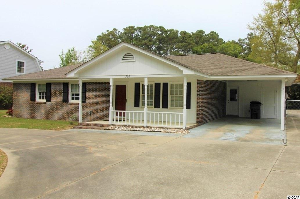 """This is NOT the home for you if you are seeking a cookie-cutter house on a tiny lot with an HOA loaded up with rules & restrictions. This recently updated 3BR/2BR brick home on a slab foundation is east of Hwy 17 Business on a ¼ acre lot with a fenced-in backyard. The custom kitchen features granite countertops & stainless-steel appliances. The flat-top stove and microwave are new. You will appreciate the slow-close kitchen drawers with custom dividers and spice drawer - all of which are part of a large work island with granite top. The spacious Carolina Room (26' x 11'8"""") with propane fireplace is the perfect spot to relax and enjoy all this home has to offer during every season of the year. The roof and HVAC are both less than 5 years old. The tankless water heater is fueled by propane. The attached carport will keep her car cool in the shade while there is still plenty of room for his boat, motorcycle and toys in the 20'x21' detached carport. There is also space to park your RV or big boat. There is an 8'x10' storage shed and an 8x'18' greenhouse/storage building which will convey. The fenced in backyard has a fire pit built into the custom wood decking. This home is located in Flood Zone """"X"""", which is NOT a high risk flood zone. The road ends less ¼ mile from this property into Murrells Inlet Creek, where you can launch a small boat or canoe to explore nature's bounty in the saltwater marsh. This home is conveniently close to retail, restaurants, The Murrells Inlet Marsh Walk and all the attractions & amenities that make this South Strand location special."""