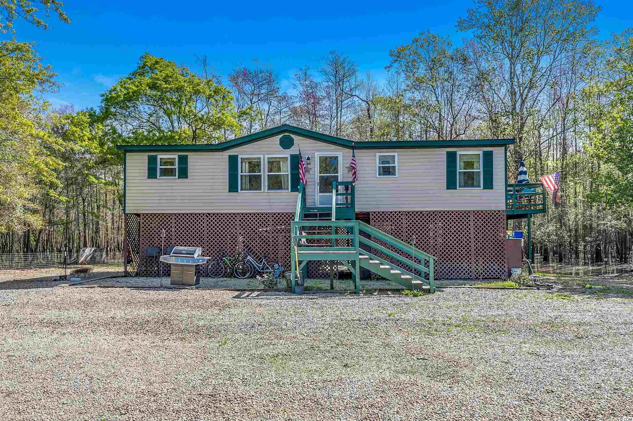 Fisherman's and nature lover's retreat. Check out this recently renovated raised manufactured home located near the Waccamaw River and nearby Lee's Landing public boat ramp. The home has a spacious floor plan with lots of storage and has new windows, a new roof, new hot water heater, laminate flooring, and updated kitchen and bathrooms. This is a great primary home or secondary residence. 20 minutes to Myrtle Beach and 10 minutes to beautiful downtown historic Conway. All measurements are approximate and not guaranteed. Buyer is responsible for verification.