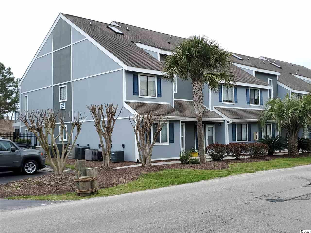 First floor AND Less then 2 miles to the beach!  Professionally landscaped, outdoor pool and hot tub, tennis courts and BBQ's are all included. Also included are: Cable AND Internet, Trash, Water AND Sewer, Pest Control AND Outside Building Insurance. Golf Colony is close to all that the Grand Strand has to offer. New garbage disposal. Hot water heater is approx. 4 years old. New washer. Hurry because this one won't last!