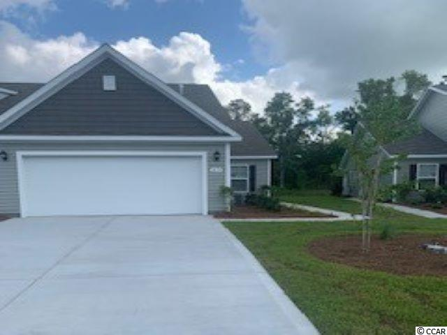 A rare opportunity of a duplex being offered in Carolina Forest that also features an attached two-car garage! Enjoy the laid back coastal lifestyle where all of your exterior maintenance is taken care of. Upon entry you are greeted with a very open layout and high vaulted ceilings. The split bedroom floor plan offers privacy when you have guests visiting you at the beach, along with functionality. This home will also have a spacious rear covered porch with pond views! Granite countertops, tankless water heater, white painted cabinetry, and stainless Whirlpool appliances with a gas range all included. This is America's Smart Home! Ask an agent today about our industry leading smart home package that is standard in every home. Blinds throughout the home also added.  *Photos are of a similar Tuscan home. (Home and community information, including pricing, included features, terms, availability and amenities, are subject to change prior to sale at any time without notice or obligation.  Square footages are approximate.  Pictures, photographs, colors, features, and sizes are for illustration purposes only and will vary from the homes as built.  Equal housing opportunity builder.)
