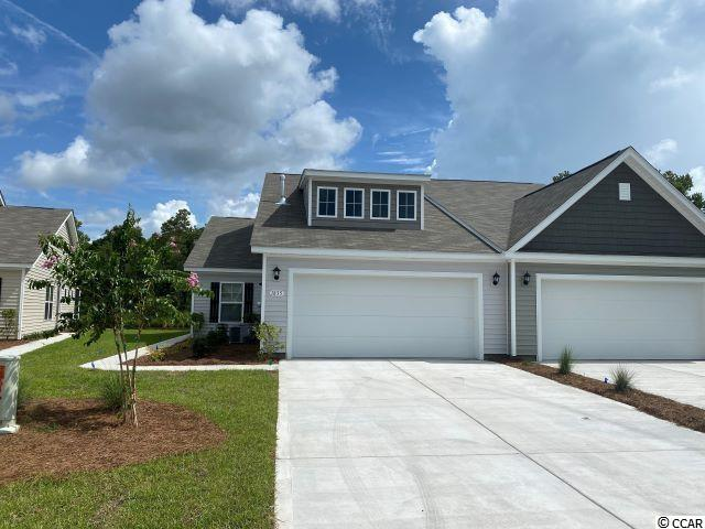 """A rare opportunity of a duplex being offered in Carolina Forest that also features an attached two-car garage! Enjoy the laid back coastal lifestyle where all of your exterior maintenance is taken care of. Upon entry you are greeted with a very open layout and high vaulted ceilings. The split bedroom floor plan offers privacy when you have guests visiting you at the beach, along with functionality. This home will also have a spacious rear covered porch with pond views that is great for morning coffee! Granite countertops, tankless water heater, 36"""" staggered cabinetry, and stainless Whirlpool appliances with a gas range all included. This is America's Smart Home! Ask an agent today about our industry leading smart home package that is standard in every home.   *Photos are of a similar Tuscan home. (Home and community information, including pricing, included features, terms, availability and amenities, are subject to change prior to sale at any time without notice or obligation.  Square footages are approximate.  Pictures, photographs, colors, features, and sizes are for illustration purposes only and will vary from the homes as built.  Equal housing opportunity builder.)"""