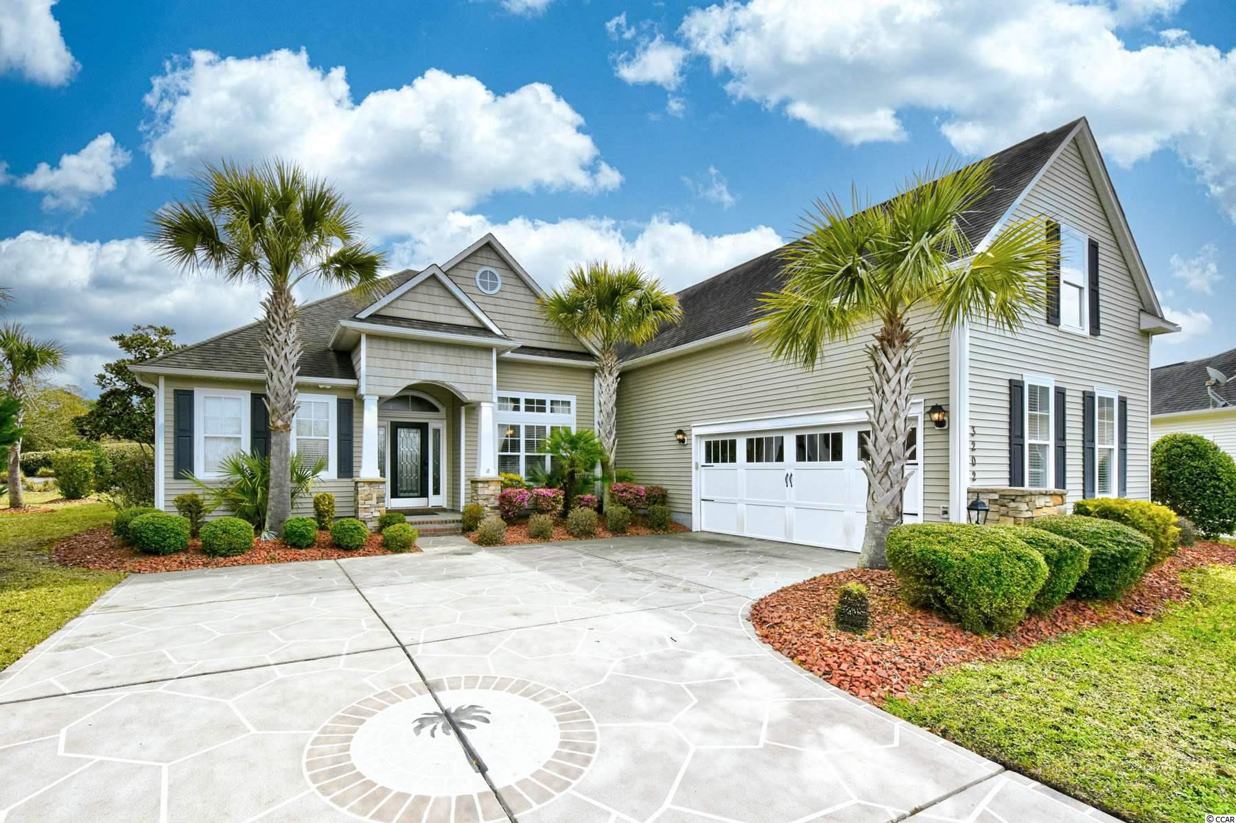 You will love this beautiful home located in Long Bridge in prestigious Barefoot Resort. As you approach the home you will notice the difference from the exterior finishes to the extensive landscaping. The foyer, formal dining room and family room have beautiful Brazilian cherry hardwood flooring. The family room is open from the kitchen with tall ceilings and fireplace. The large kitchen has 42' maple cabinets, granite counter tops, tile flooring and stainless steel Kitchen Aid appliances .The master bedroom is huge with tray ceilings and the master bath raised vanities with double sinks, tiled shower, and whirlpool tub. The fourth bedroom has it's very own bathroom. Off the back of the home is a large screened porch with tiled flooring, stoned courtyard patio with fireplace where you can barbecue and enjoy your favorite beverage after a day at the beach, or golfing. The HOA dues covers membership in the Barefoot Residence Club with fitness center, Olympic swimming pool, Clubhouse, tennis, and basketball courts. The HOA dues also covers membership in the Barefoot Beach cabana with shuttle service, private access and gated parking for the property owners. There is a marina with jet ski and boat rentals.