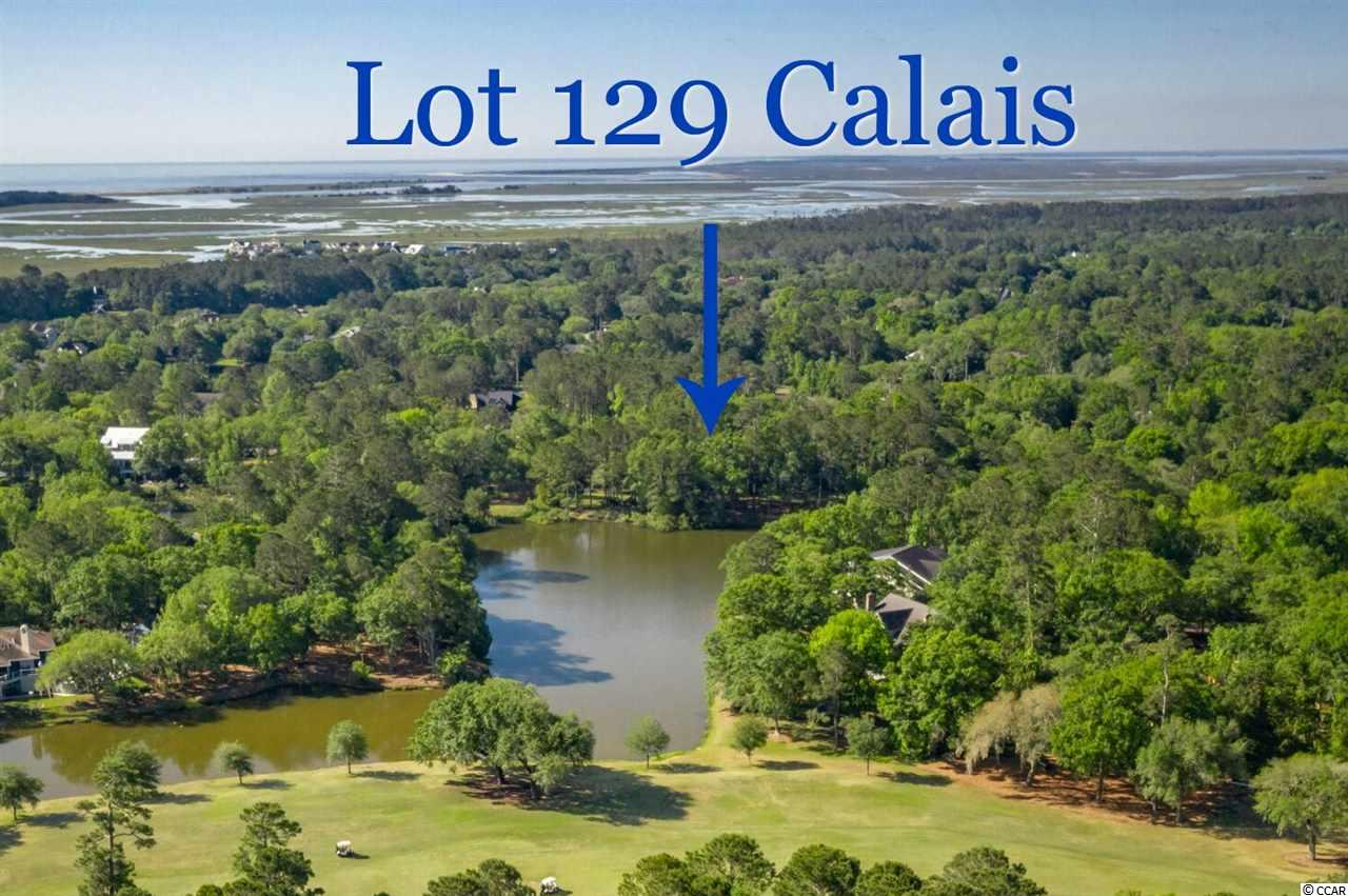 DeBordieu Colony - If it's a lake view you're looking for, look no further! Take your golf cart to the beach from the home you will build on this beautiful Lake Front lot, loaded with Live Oaks! Lot 129 Calais offers a high elevation, so you don't have to build a raised plan, unless you want to take the fabulous water view to new heights! The view is straight down the long lake to the golf course way in the distance. Located in the heart of the DeBordieu Golf Course Community, less than a mile and a half to the beach, your home will be in the center of all DeBordieu Colony offers it's residents. Lot Dimensions of this Northern exposure lot are 100 x 333 x 100 x 332.    Ask about the raised floorplan designed by architect Steve Goggans, available to the buyer that was specifically designed for this lot!  It is already in the ARB approval process, which will save you time and energy! DeBordieu Colony is a very private community on the coast of South Carolina, between Charleston and Myrtle Beach, just south of Pawleys Island. In addition to 6.5 miles of secluded beach, boat landing access to North Inlet, and a 24-hour manned security gate, the private, equity DeBordieu Club offers Pete Dye golf, a tennis and fitness center and an ocean front Beach Club with fine dining, a gazebo bar, two pools, and a playground. There is truly no place like DeBordieu Colony. Come see for yourself!