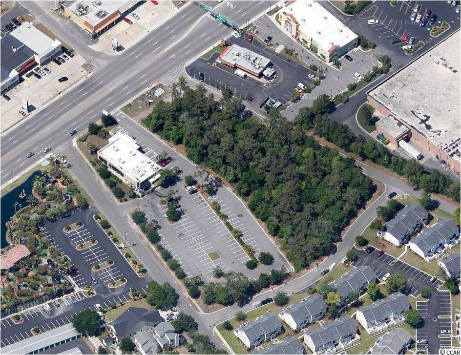 1.5 Acre corner site with excellent exposure and access on U.S. Highway 17 in the City of North Myrtle Beach, South Carolina. This site is currently undeveloped; Corner Lot at 1st Ave in North Myrtle Beach. The site is contiguous to and shares common access from Highway 17 with Bonefish Grill. Situated only blocks South of Home Depot, Lowes, and Walmart.