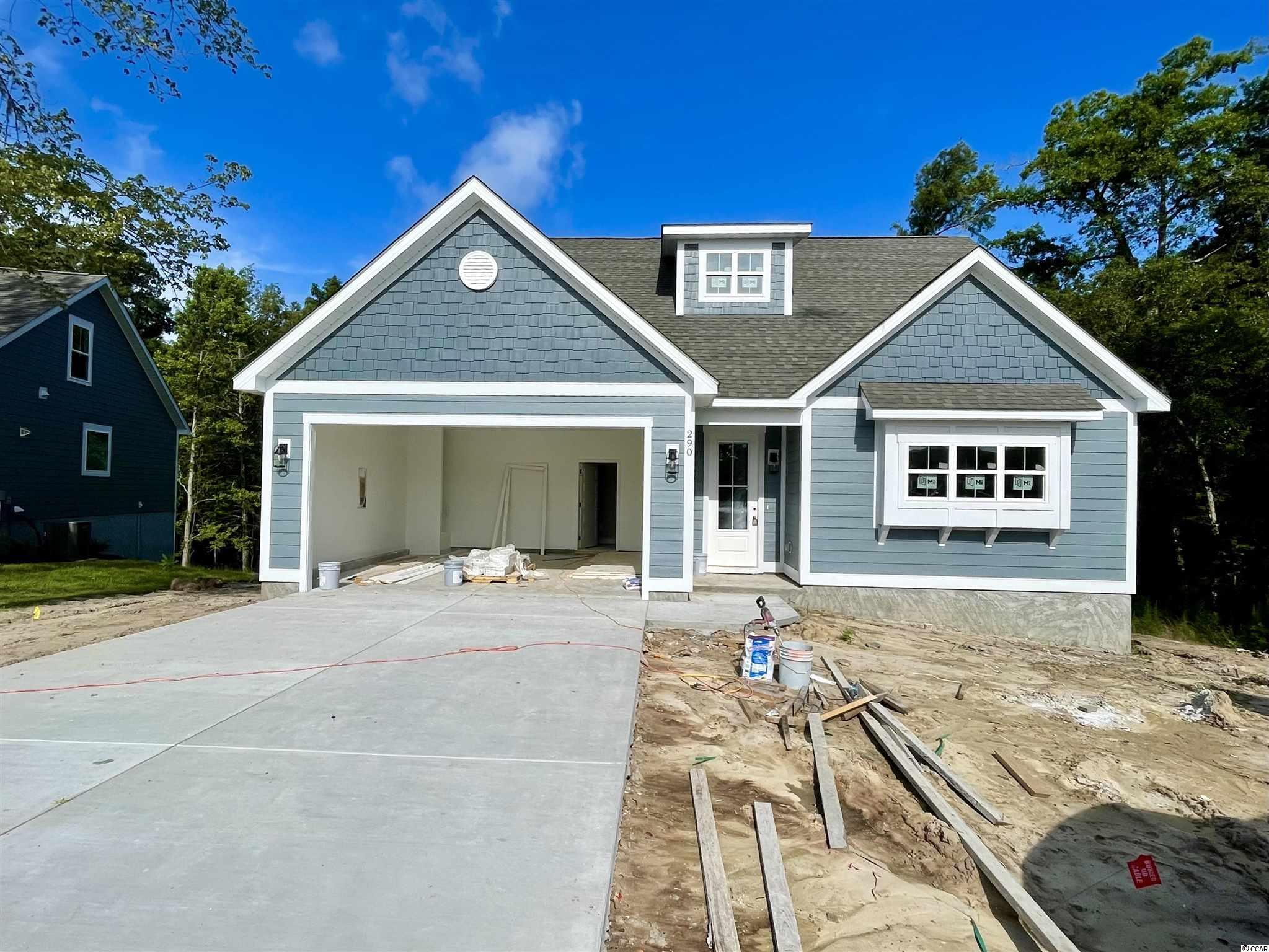 This home is expected to be completed in June/July 2021 This 3 bedroom/2.5 bath home is currently under construction on a beautiful and private lot in the gated community of Rivers Edge Plantation. Rivers Edge Plantation is located off the popular Highway 90 corridor, and is only minutes from all the Grand Strand has to offer via International Drive or SC Highway 22. The community features a private boat launch, dock, clubhouse, pool, and playground. This home will feature a first floor master suite, covered back porch overlooking a wooded area and a stream. Additional features include a natural gas fireplace, natural gas cooking, beautiful kitchen with granite countertops, Luxury Vinyl Plank Flooring, LED lighting, soft close cabinetry, high end trim upgrades, and more! Check back often for construction updates, or contact an agent for more information! Builder is accepting pre-completion offers, secure this home today!