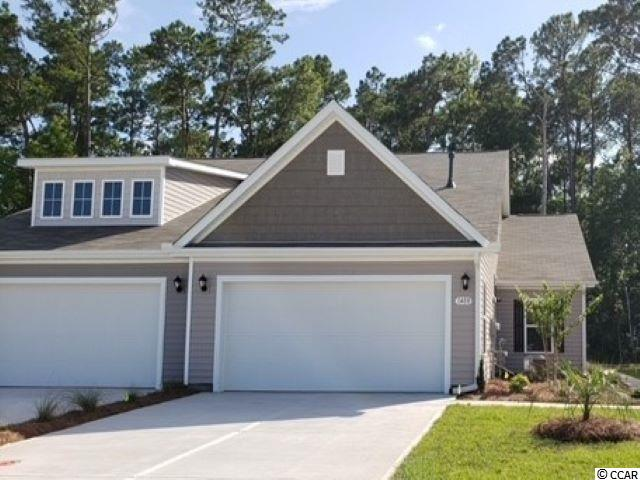 Lovely, low maintenance paired ranch home in a brand new natural gas community where homeowners will enjoy a spacious clubhouse with sprawling verandas, impressive swimming pool, conditioned fitness center, fenced dog park, playground area, and blueberry garden! This Tuscan floorplan offers a spacious, open layout all on a single level. With vaulted ceilings, tons of natural light throughout the living and dining areas, large kitchen island with breakfast bar, and spacious covered porch, this home is perfect for entertaining! The kitchen also features granite countertops, stainless Whirlpool appliances, gray painted cabinetry, and a large pantry with ample storage. Roomy primary bedroom suite with walk-in closet and private bath with dual vanity and 5 ft. walk-in shower. This home also features laminate wood flooring throughout the main living areas, a tankless gas water heater, and our industry leading smart home technology package. Yard and exterior maintenance are all covered! 4' black aluminum fencing is permitted (per HOA approval).  *Photos are of a similar Tuscan home. (Home and community information, including pricing, included features, terms, availability and amenities, are subject to change prior to sale at any time without notice or obligation. Square footages are approximate. Pictures, photographs, colors, features, and sizes are for illustration purposes only and will vary from the homes as built. Equal housing opportunity builder.)