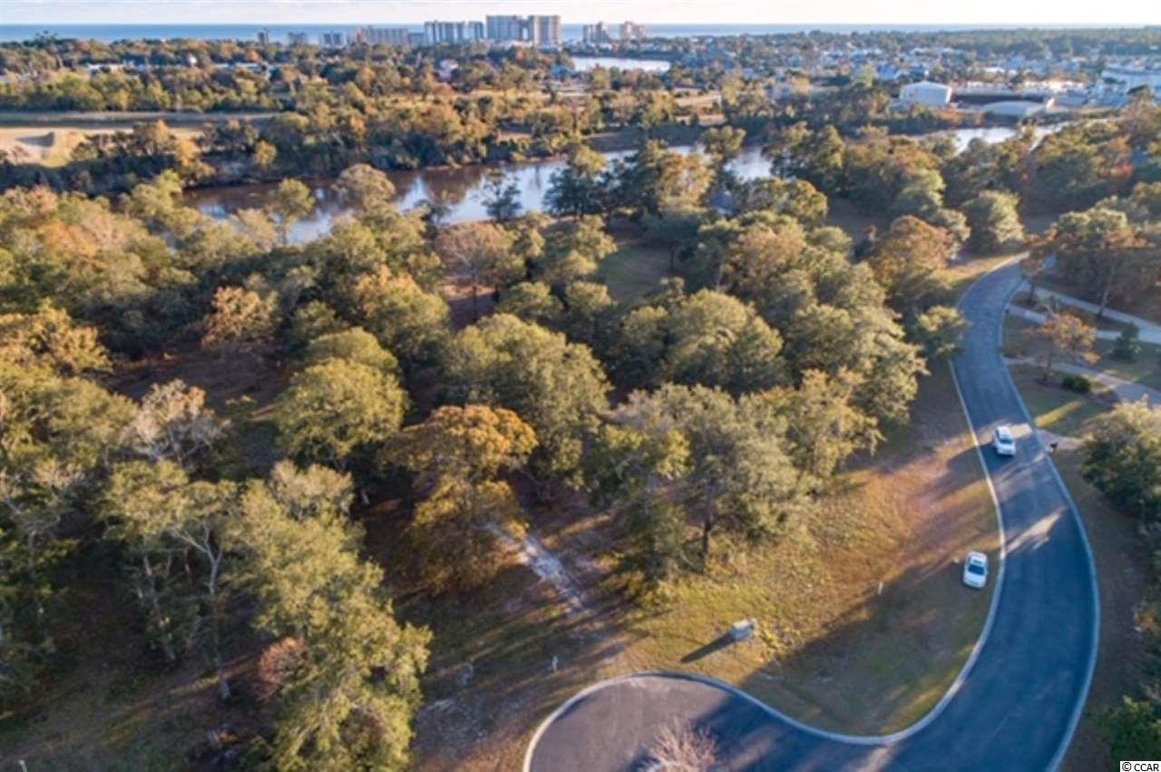 Incredible opportunity to purchase this spectacular 1.49 acre lot located directly on the Intracoastal Waterway in the exclusive gated Dye Estates community at Barefoot Resort & Golf. This is one of the largest waterway lots in the Dye Estates community. Property is only one of three in neighborhood that have unobstructed views of both the Intracoastal Waterway and the nationally ranked Dye Course. Additional features include: 125 feet of waterway frontage, beautiful hardwood trees, and a private dock permit (not shared like most other communities). The Dye Estates is the upscale custom home neighborhood at Barefoot that offers a privately gated entrance with 24/7 security staff. A transferable Dye Club golf membership is available with the sale. The Dye Estates offers three championship golf courses designed by Davis Love, Tom Fazio, and Greg Norman. Barefoot also features a marina with slip rentals, a 15,000 square foot salt water swimming pool, on-site restaurants, two multi-million dollar club houses, and all owners enjoy membership to the Barefoot Beach Cabana that is just minutes by car or your golf cart. Come live the Barefoot Resort lifestyle. Call today for a showing !