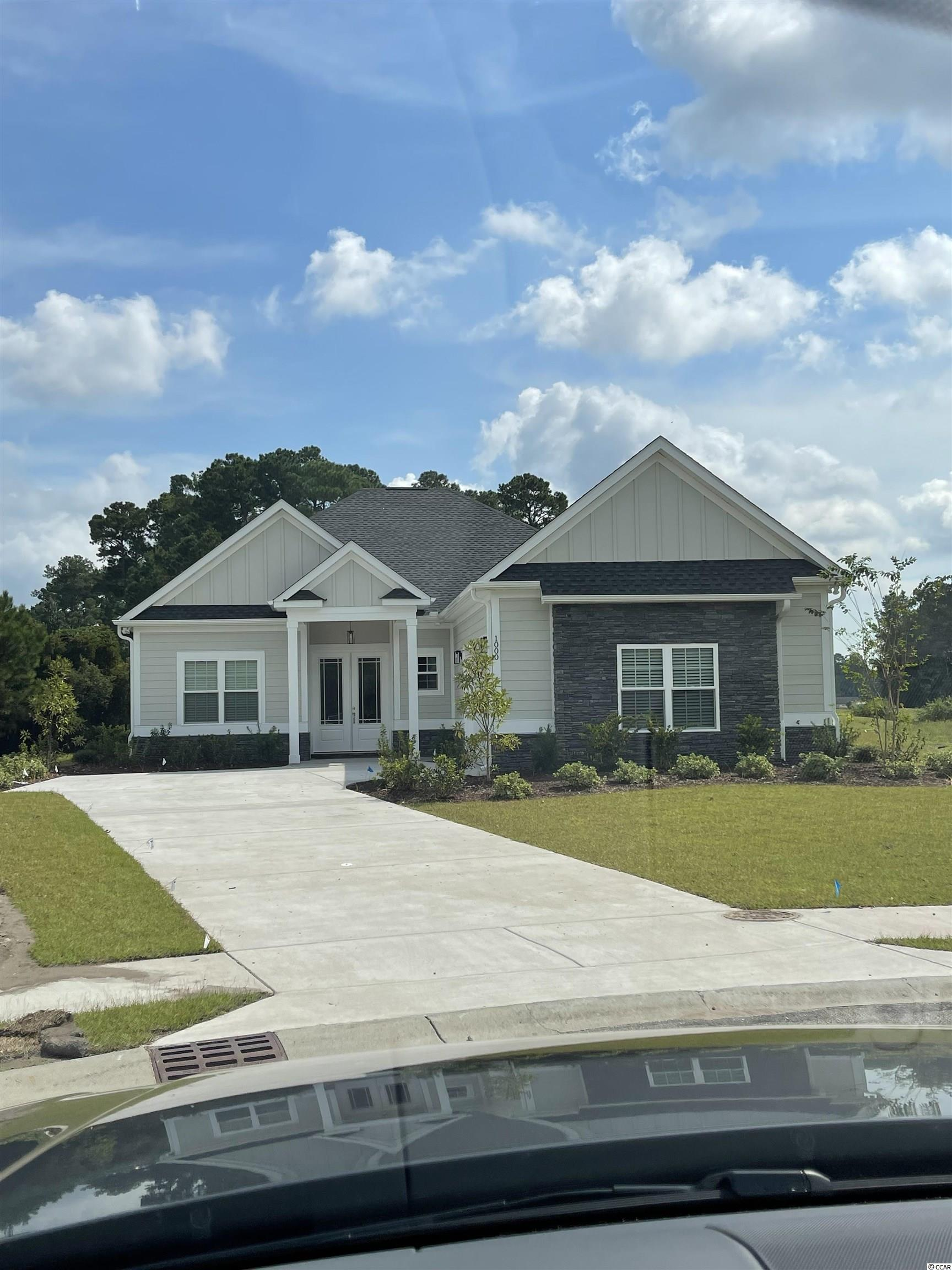 This beautiful new construction home is under construction and will be ready for a lucky buyer in August 2021! Located in the Wild Wing Plantation community that has a World class golf course and an amenities center that is amazing!. As you will enter this perfectly laid out open floor plan home will notice right away the upgrades and quality of work are above and beyond other larger builders in the area. This is a 100% custom home and it shows!. With LVP flooring throughout, Hardie board siding, upgraded countertops, tankless gas water heater, soft close all wood cabinets, all showers are tile including a large shower and tub in the master bathroom, custom wood shelving in your oversized master walk in closet, large tray ceilings, appliances credit will be given, crown molding and upgraded lighting package. Community has two entrances/exits which makes for easy access to all shopping, restaurants, medical facilities, Coastal Carolina University and two Highways for a quick drive to anywhere on the beach!. Buyers if purchase in time will be given choices for certain finishes. Pictures are of a completed similar home in the community. Book your showing today as you will not be disappointed! Located on a quiet cul de sac and golf course!
