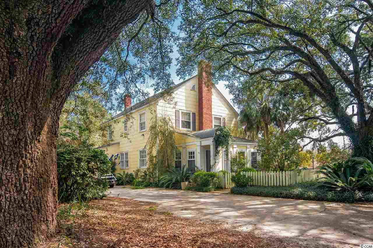Welcome to 220 Duke in downtown historic Georgetown.  This classic home is nestled beautifully on the edge of the marsh that boarders the merge of the Black and Pee Dee Rivers.  Upon arrival, you are greeted by a charming courtyard that catches the breeze off the marsh. Take a moment to enjoy the outdoor entertaining area.  The home features a traditional floor plan on the first floor with formal living room with a fireplace and a dining room area, a french country inspired kitchen, a den, and a primary suite with private living area.  Upstairs you will find a second primary bedroom and bath, and two additional bedrooms with a shared bath.   Most rooms are gracious in size and feature handsome moldings and hardwood floors that are found in many homes of its age.  220 Duke is within walking distance of downtown parks and the East Bay street boat landing and kayak launch.  Take a short ride by car, bicycle, or golf cart to downtown Front street where you can indulge in great shopping, dining, tours, and more!