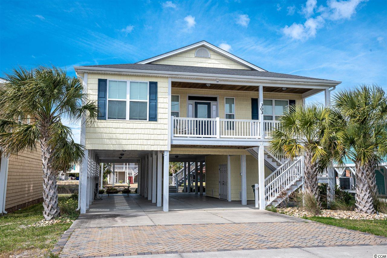 STUNNING BEACH HOUSE. This 4BR/3BA CUSTOM-BUILT CHANNEL HOME is located in the Cherry Grove section of North Myrtle Beach.  The owners spared no expense.  So many great features in this prestigious home including engineered hardwood and tile flooring throughout, granite countertops in the kitchen, as well as all bathrooms, stainless steel appliances, eat-in breakfast bar for extra seating, 9' ceilings, 11' ceilings in the main living area with finished tongue & groove pine, recessed lighting, walk-in showers and a tub in the home, an outside shower, separate laundry room, home elevator, a large storage room for all your beach chairs and can also be used as a workshop, vinyl shaker shingle siding, Trex decking on both front and back porches and stairs, and comes FULLY FURNISHED with quality home furnishings in every room.  All appliances convey, including the washer and dryer. This home is turn-key.  Only steps away from the beach, close to the quiet and picturesque Point at Cherry Grove, golf cart ride to Coastal North Town Center shopping, live entertainment on Main Street in OD, restaurants, beach shops, and so much more!  Do not miss out on this spectacular beach home! It will not last long. Square footage is approximate and not guaranteed. Buyer is responsible for verification.