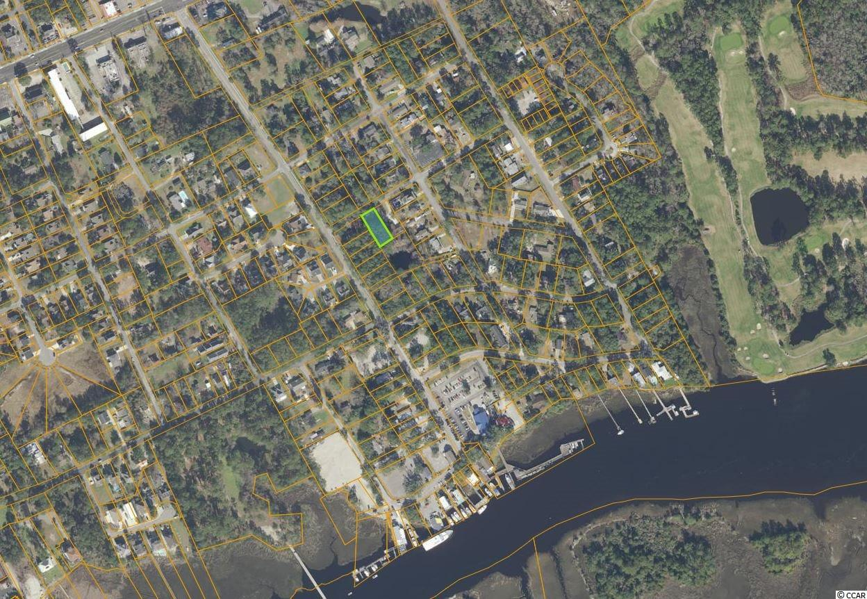 Great building lot for your dream home!  Just 2-3 blocks from the waterway and the beautiful Little River Waterfront, The Blue Crab Festival, Restaurants, and other waterway attractions, this lot is in a great location.  Water, sewer and electric are available at the street.  No building restrictions and no time restrictions so you can build whenever you like, using whatever builder you prefer.