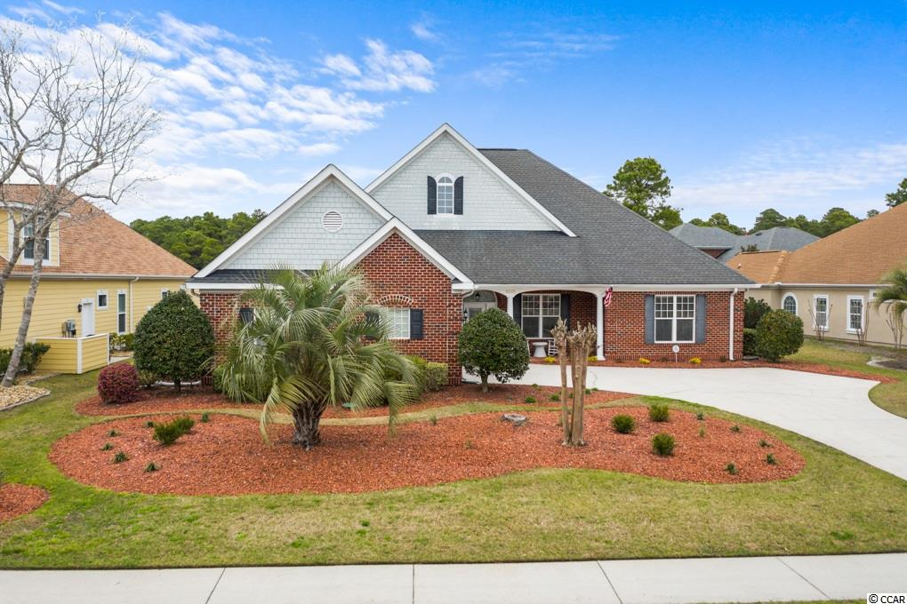This custom built -  traditional all brick home on is on a premium water lot in beautiful Plantation Lakes. This grand home  includes 4000 SF of living space, 4 Bedroom / 3.5 Bath / One bedroom / Bonus space is upstairs with full bath and balcony over looking the water.  On the main level of this home you will find the Owners Suite along with 2 additional bedrooms, 2 full bathrooms and 1 half bath.  A gourmet kitchen, great room, office, Dining, and Carolina Room.  All of the living is done on the main floor.  Upstairs you will find a large bedroom / Bonus space, Full Bath,  as well as additional storage.  This home is abundant in storage.  This home boasts authentic hardwood flooring throughout the home, including the bedrooms.  Tile in all the wet areas.  The great room overlooks the beautiful lake, with soaring ceilings and custom built-in cabinets.  The kitchen is fit for a chef and perfect for entertaining.  With granite countertops, beautiful wood cabinets, double ovens, one is also convection, a gas cook top, area for a wine refrigerator, a second prep sink in the large island, and walk in pantry.  The owners suite overlooks the lake and boasts a large jetted soaking tub and huge walk in shower.  Other features of this home are the ramp on the dock that allows you to easily get water toys in and out of the water.  Entire House surround sound.  This home has a separate work room / craft space with a concrete floor and large exhaust system to remove fumes as you work away.  This home has a very efficient hybrid HVAC system that utilizes electric and gas to maximize energy savings.  You will also fined a zoned irrigation system that is on a separate meter which saves money on watering the lawn.  You will be pleasantly surprised by incredible walk in attic space that could easily be finished as additional living space or just serve as a fantastic storage area.   This home was designed with easy living in mind.  Almost every room looks over the lake.    Plantation