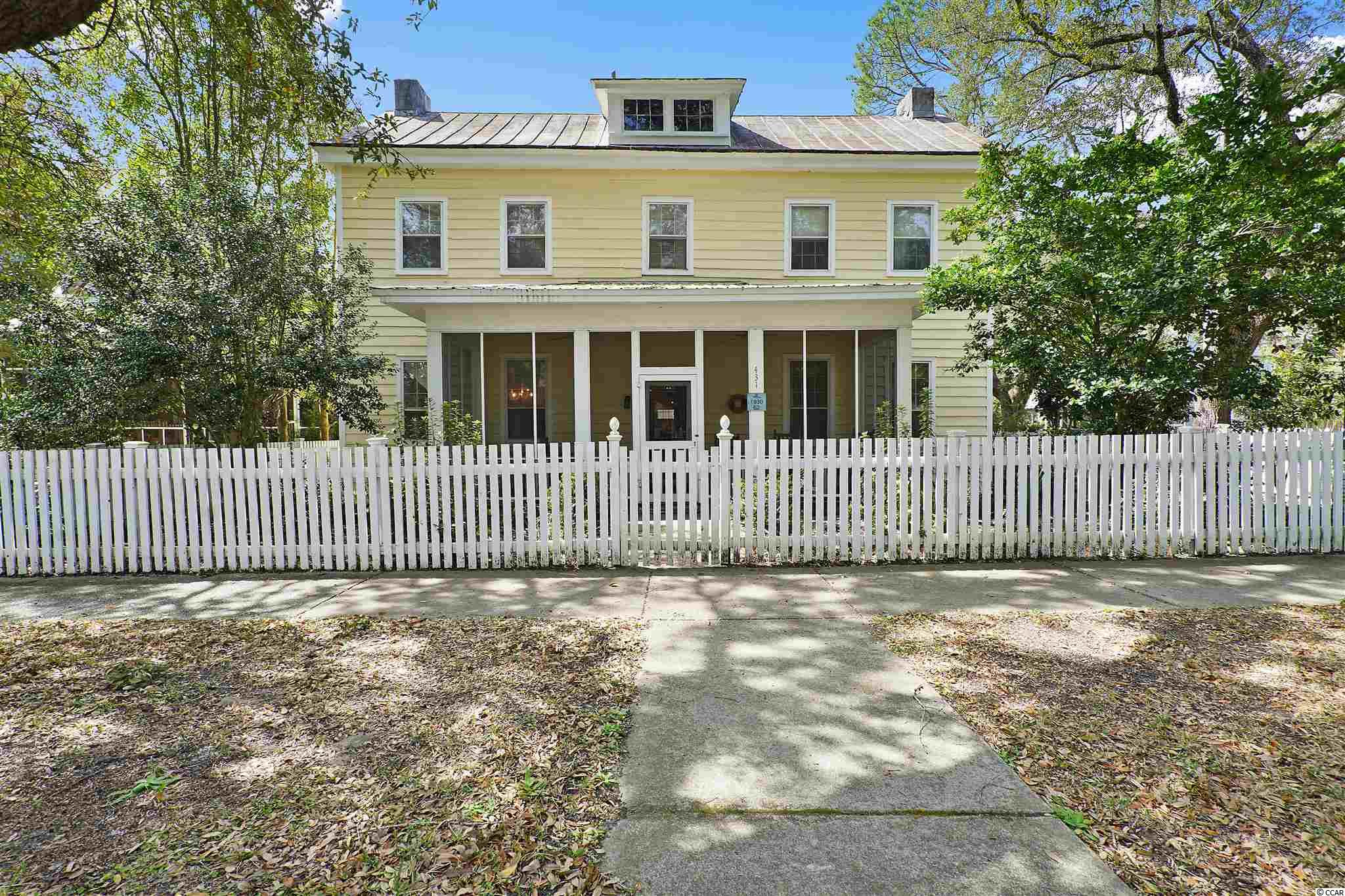 The storybook home you've always dreamed of- white picket fence, large screened in front porch, and live oaks stretching over the sidewalk. This historic property is in a fantastic location at the center of downtown Georgetown- Just 2 minutes from the Marina, and walking distance to numerous shops, and restaurants. Quite a few upgrades were made in 2020, including: New duct work under the home, new hot water heater, new heating system on the second floor, and refinished back driveway. Inside, you have over 2,900 sq ft for your growing family with 5 bedrooms, 4 baths and plenty of space in between. You'll fall in love with the crown molding detail, original hardwood floors, and charming brick fireplaces. The first floor conveys a formal dining room, large living space, a spacious eat-in kitchen, a flex room currently used as a home office, and one bedroom and full bath. On the second floor, there are four spacious bedrooms and three separate bathrooms. This home is full of character, history, and in a great place to raise your family. It won't stay on the market for long, so come see it today!