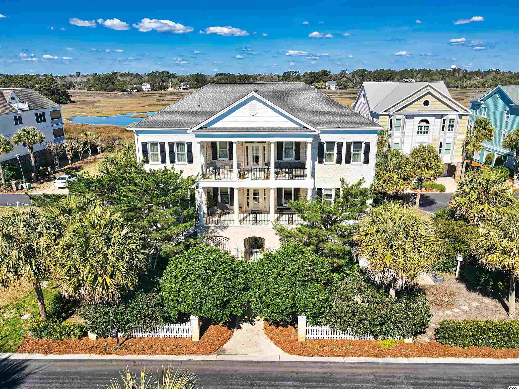 """Welcome to 592 South Dunes Dr! This lovely home is located in Charlestowne Grant, a gated enclave of exclusive Oceanside homes in the gates of desirable Litchfield by the Sea.  This newly updated, stately, all brick home has all the luxuries you have dreamed of in your beach retreat and just a two minute walk to the beach.  This ocean and marsh view home has spacious bedrooms and large living areas perfect for entertaining family and friends.  Timeless quality was applied throughout; exemplified by the reclaimed antique heart pine flooring throughout the bedrooms and living spaces.  All baths feature 24"""" x 24"""" Calacatta marble, Italian sinks, and Italian or German hardware.  Clean-lined beauty, ergonomic perfection and German engineering complete this custom Bulthaup kitchen. Truly a gourmet chef's dream come true, the kitchen features a Miele refrigerator and freezer, Miele oven, Fisher Paykel dishwasher drawers, and GE Profile smooth cooktop.  Share a special meal together with guests in the spacious dining room with light reflected from the marsh.  Enjoy Cocktails on the upstairs veranda, especially in Summer when the porch is shaded and we have a cool, beautiful breeze off the ocean.  The master suite boasts of a fireplace, amazing custom walk in closet, tub and Calacatta marble shower. Navien Tankless Hot Water Heater – propane fuel and a circulator mean you never wait and have bottomless hot water.  On the main level there is a handsome study that could be used as a fourth bedroom or playroom.  Other features of this well-appointed home include:  gas fireplace in living room, 10' ceilings upstairs and down, elevator, beach shower and bathroom in the garage.   The exterior has lush, mature landscaping, hurricane shutters and gated entry with a fountain.  Enjoy views of the Atlantic Ocean from the front porches and marsh views from the back.  592 South Dunes Drive is a private home and has never been rented.  Litchfield by the Sea owners enjoy private beach acce"""